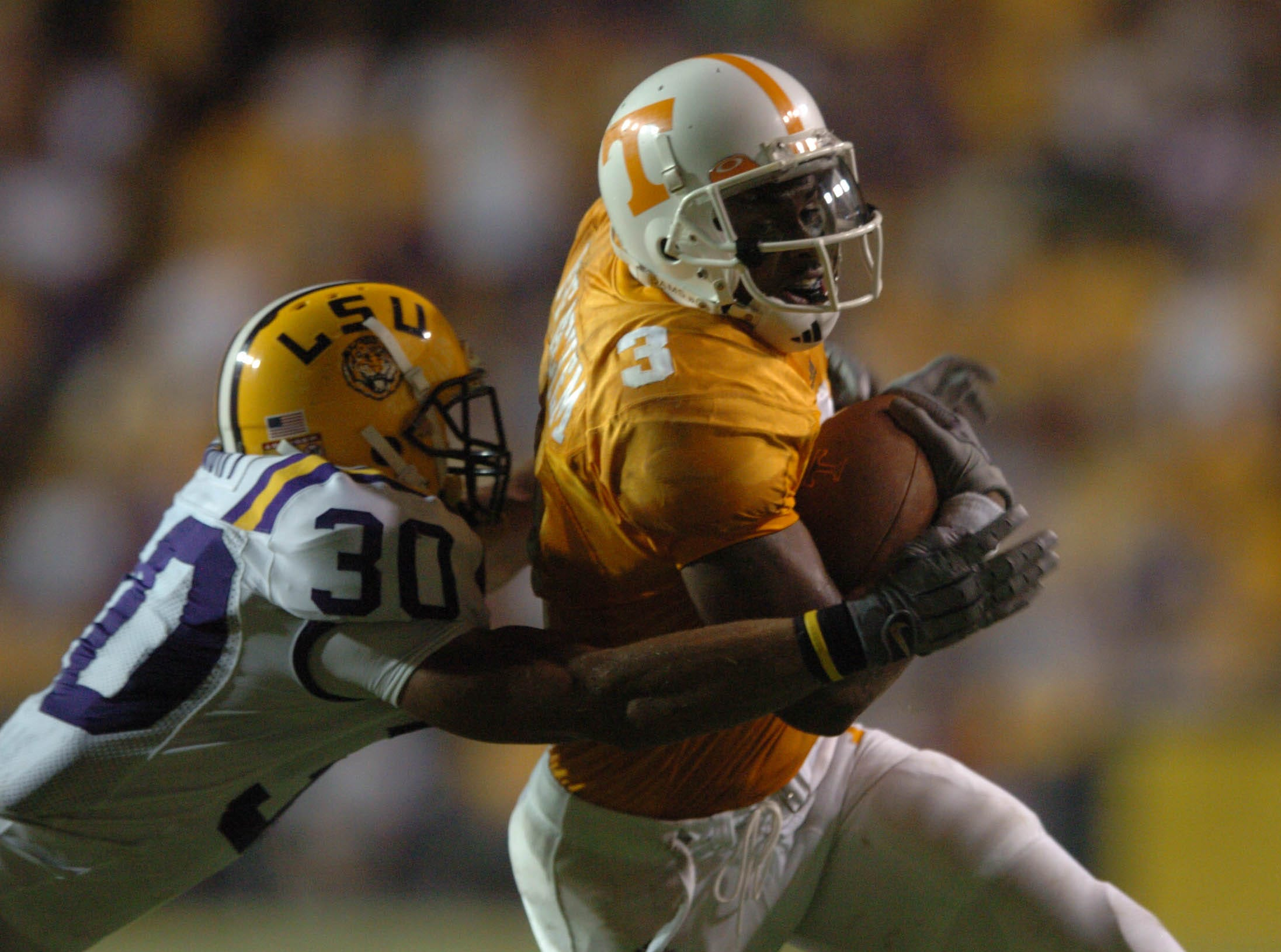 UT's Robert Meachem, right, gets past LSU's LaRon Landry in the second half Monday in Baton Rouge.  Tennessee beat LSU in overtime 30-27. 09/26/2005