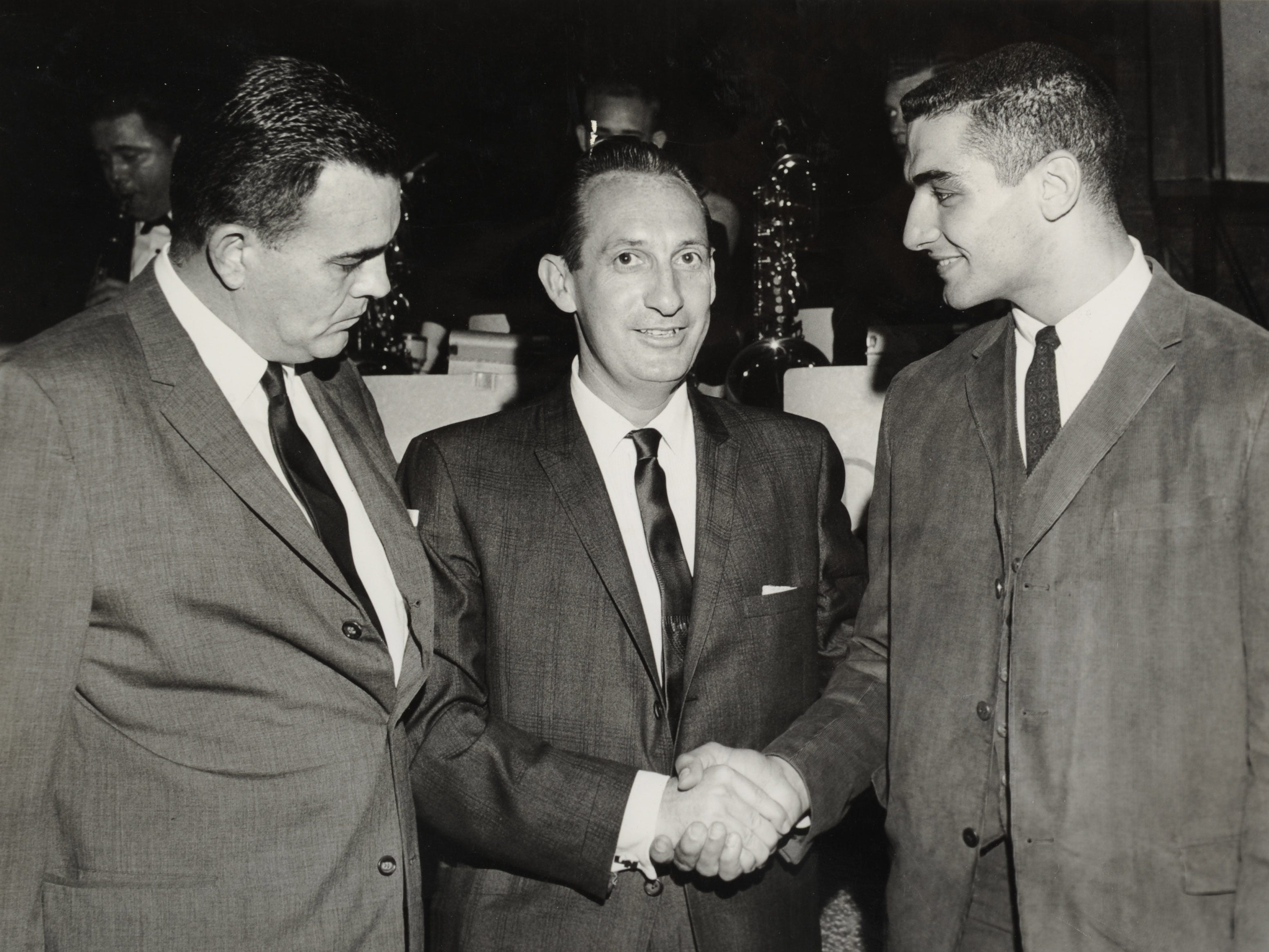 In a December 1961 photograph, University of Tennessee coach Bowden Wyatt, left, NBC-TV announcer Lindsey Nelson and center Mike Lucci are seen during the Vol football banquet at the C'est Bon restaurant on Alcoa Highway. Lucci is being congratulated for being named to the All-Southerneast Conference team.
