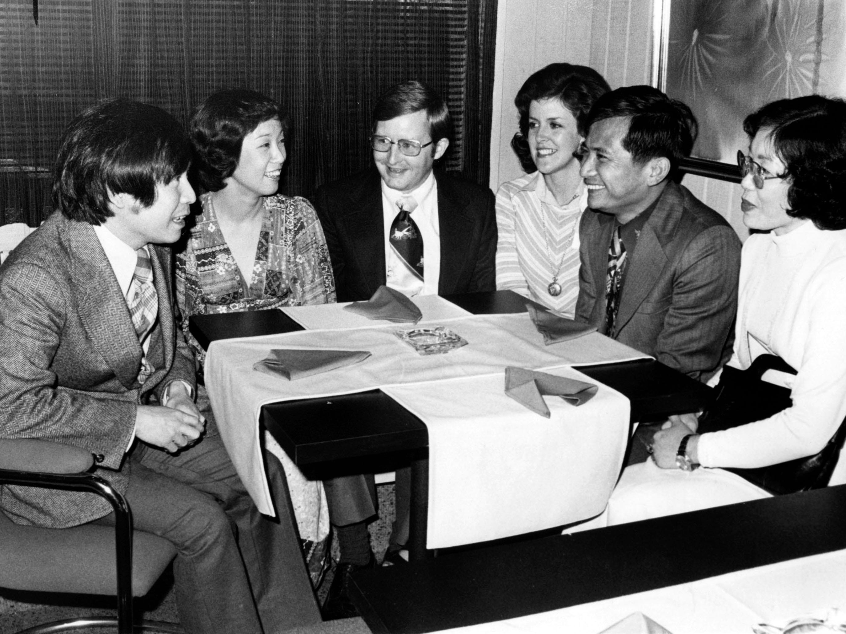 From left, Hao Siew Po, Janet Hao, owners of China Inn Restaurant, Richard Powell, Docia Powell, and Mr. and Mrs. Lin Ping Wen dining at China Inn Restaurant in 1976.