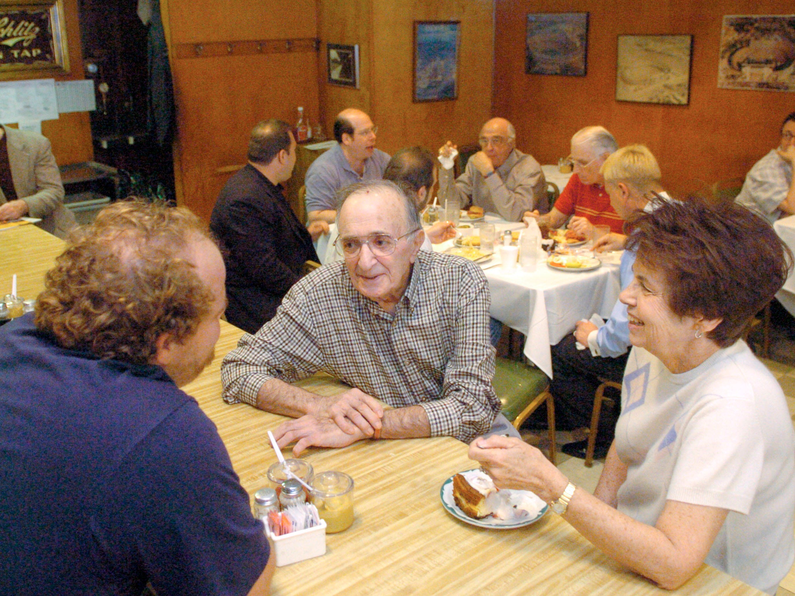 In 2005, Bruce Bogartz talks with Harold Sherskey, who has operated Harold's Kosher Deli for over 50 years and  Marilyn Burnett, a long time customer and friend of Sherskey's. Harold's Kosher Style Deli at 131 N. Gay Street is changing owners. After operating the N. Gay Street Deli for over 50 years, Sherskey is turning over day to day management of the landmark to local chef Bruce Bogartz.