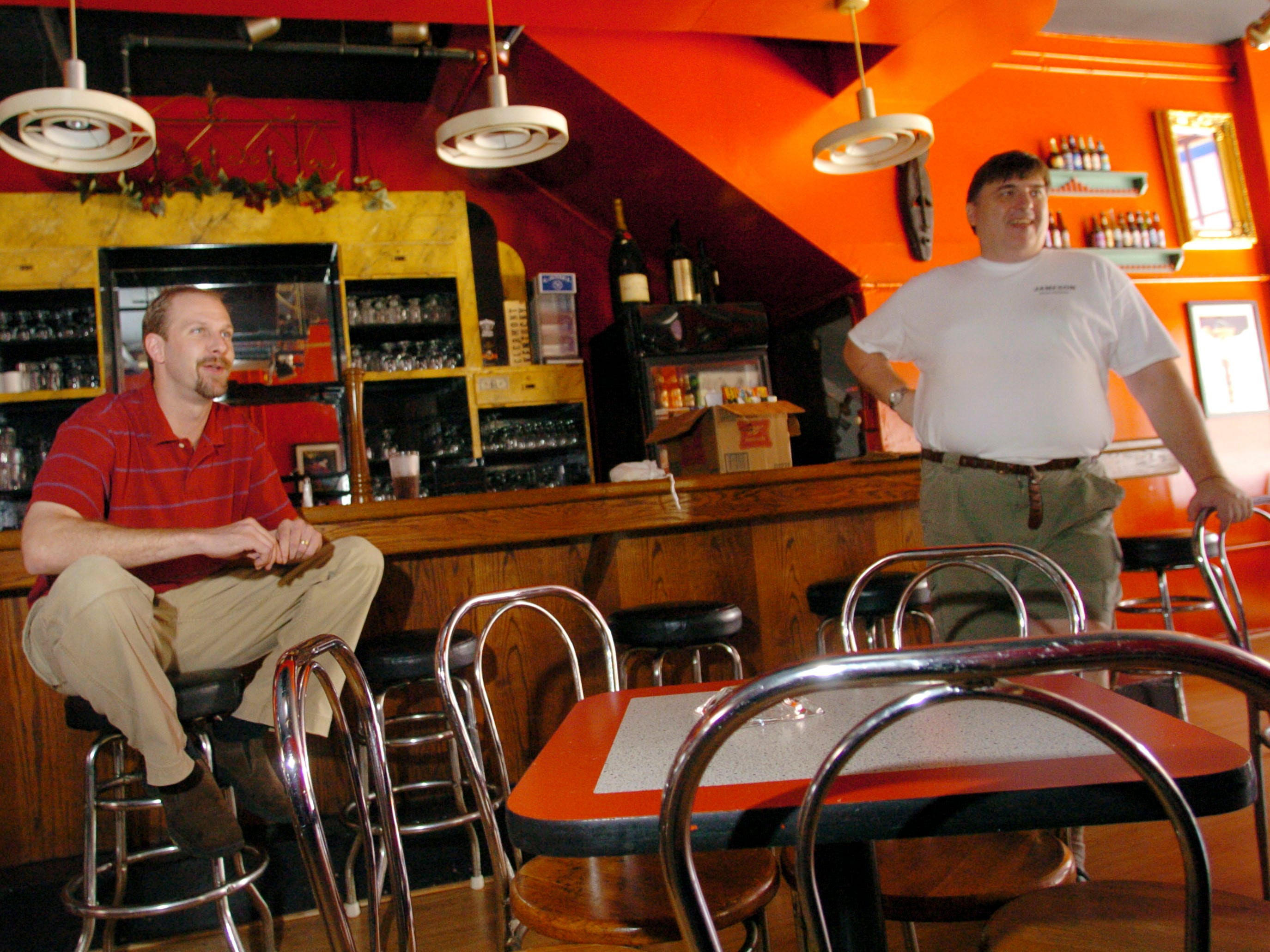 Lucille's general Manager Sean Blair, left, and owner Frank Gardner talk about the future of the popular Old City night spot in 2004. The eatery will be kept open as part of their Partick Sullivan's restaurant and will have a more casual atmosphere.