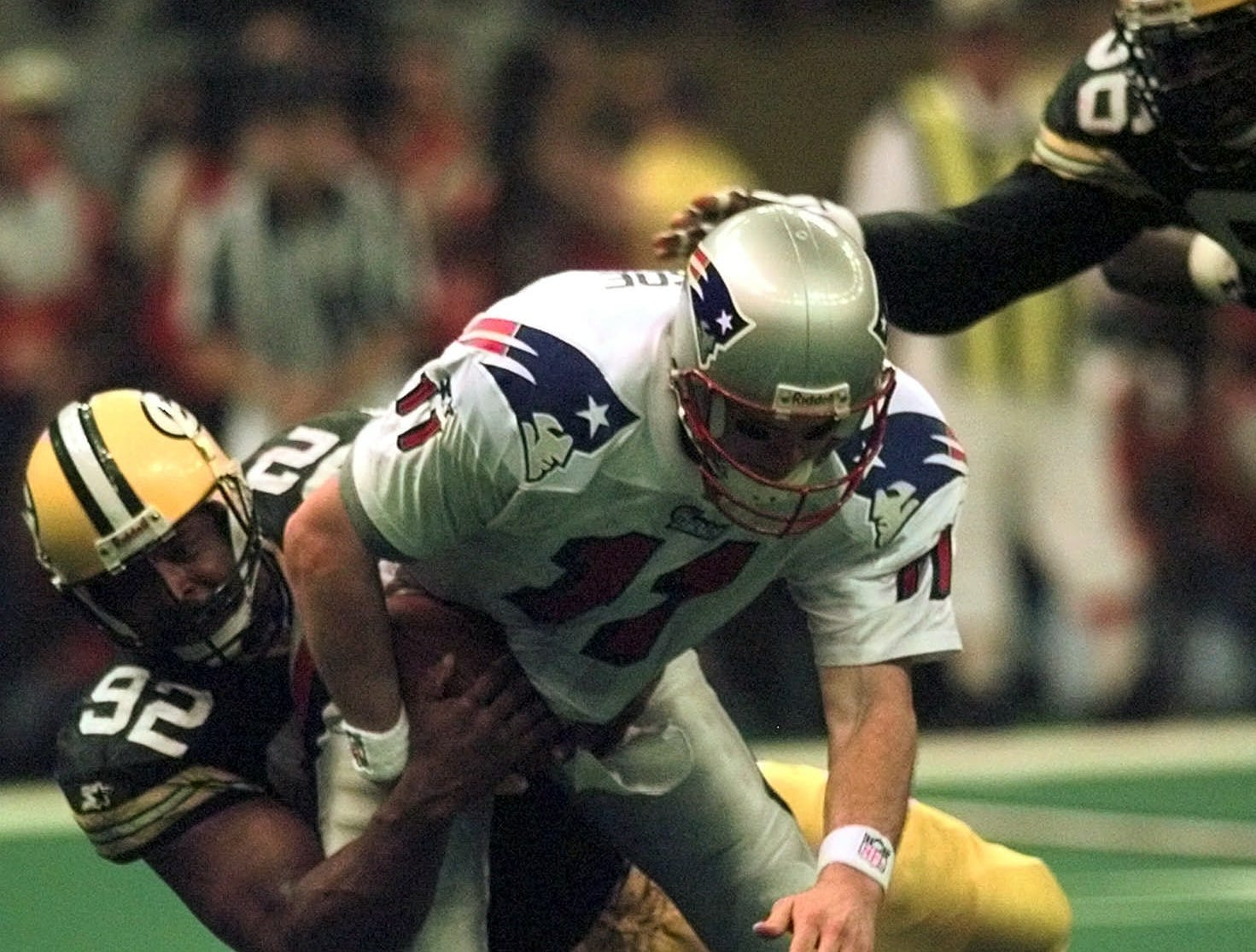 Green Bay Packers defensive end Reggie White (92) sacks New England Patriots quarterback Drew Bledsoe (11) in the third quarter of Super Bowl XXXI Sunday, Jan. 26, 1997 at the Superdome in New Orleans.