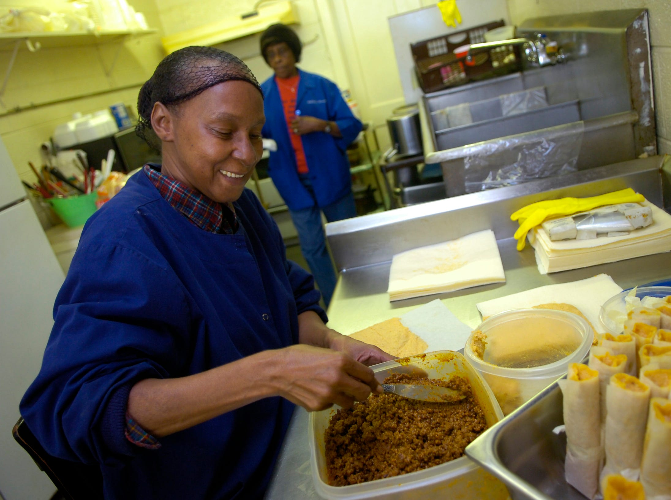 "Rosa Paschal works on a batch of tamales at Mary's Hot Tamales on Magnolia Avenue in Knoxville in 2008. The store has been serving ""delta"" style tamales since 1989."