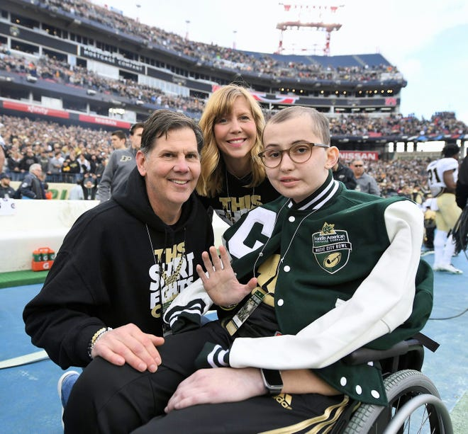 Tyler Trent waves at the Music City Bowl where Purdue football competed against Auburn on Dec. 28, 2018, at Nissan Stadium in Nashville, Tennessee