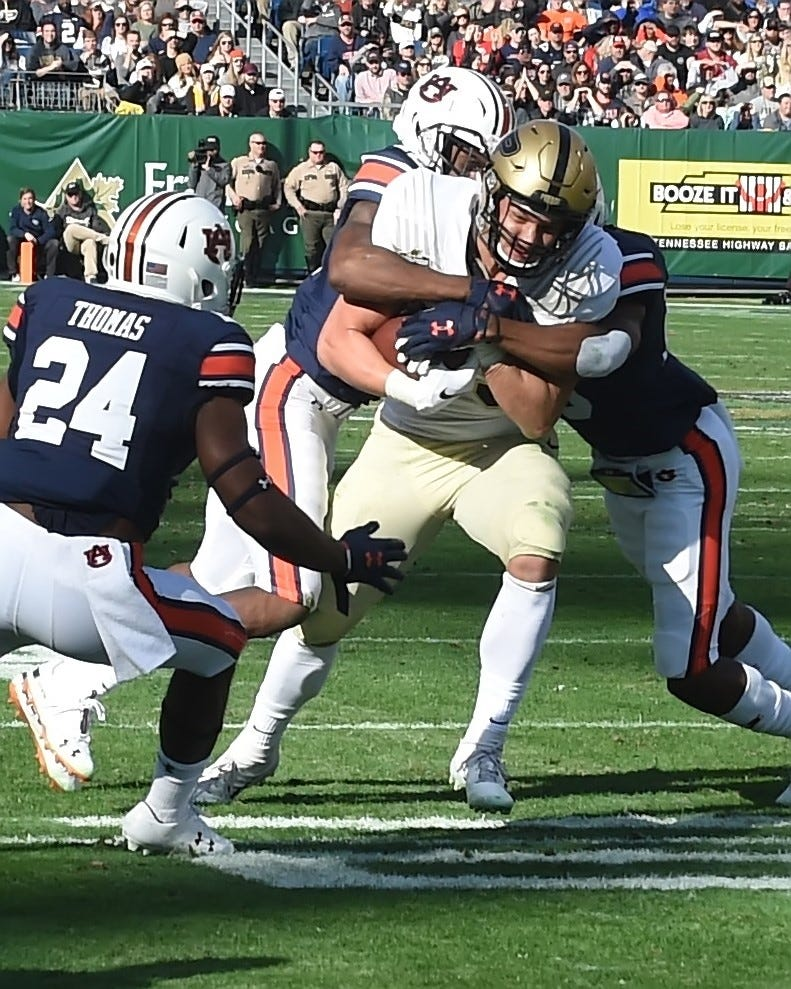 Purdue tight end Brycen Hopkins takes a reception inside the Auburn 10 during the Music City Bowl in Nashville.