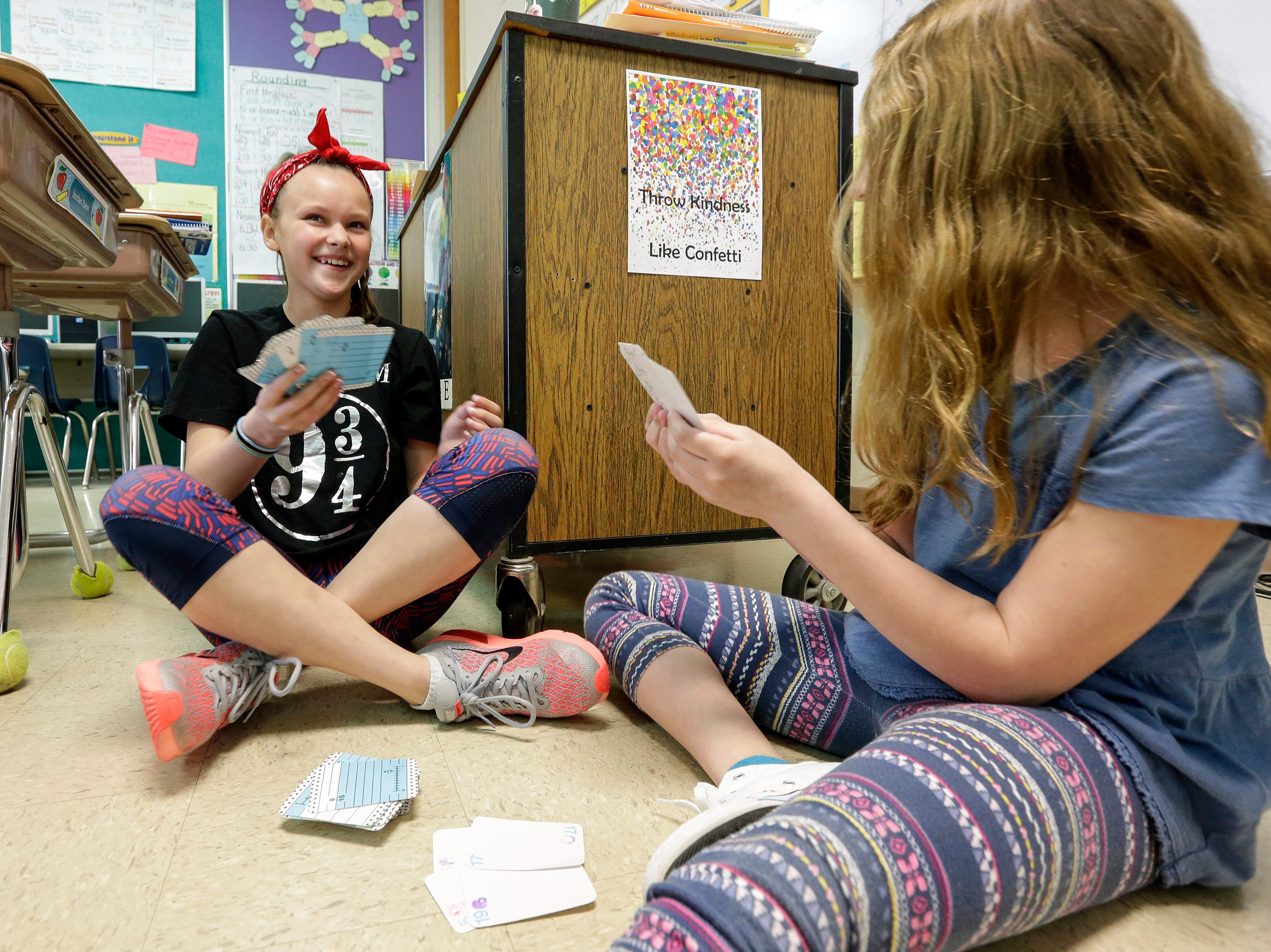 Fifth-grader Debin Talley, left, plays a math game with classmate Addison Talbert during a math lesson at Stangel Elementary School Thursday, May. 3, 2018, in Manitowoc, Wis. Under a new MPSD proposal, Stangel students would move to Riverview Early Learning Center, which would become a 4K through fifth-grade elementary school. Josh Clark/USA TODAY NETWORK-Wisconsin