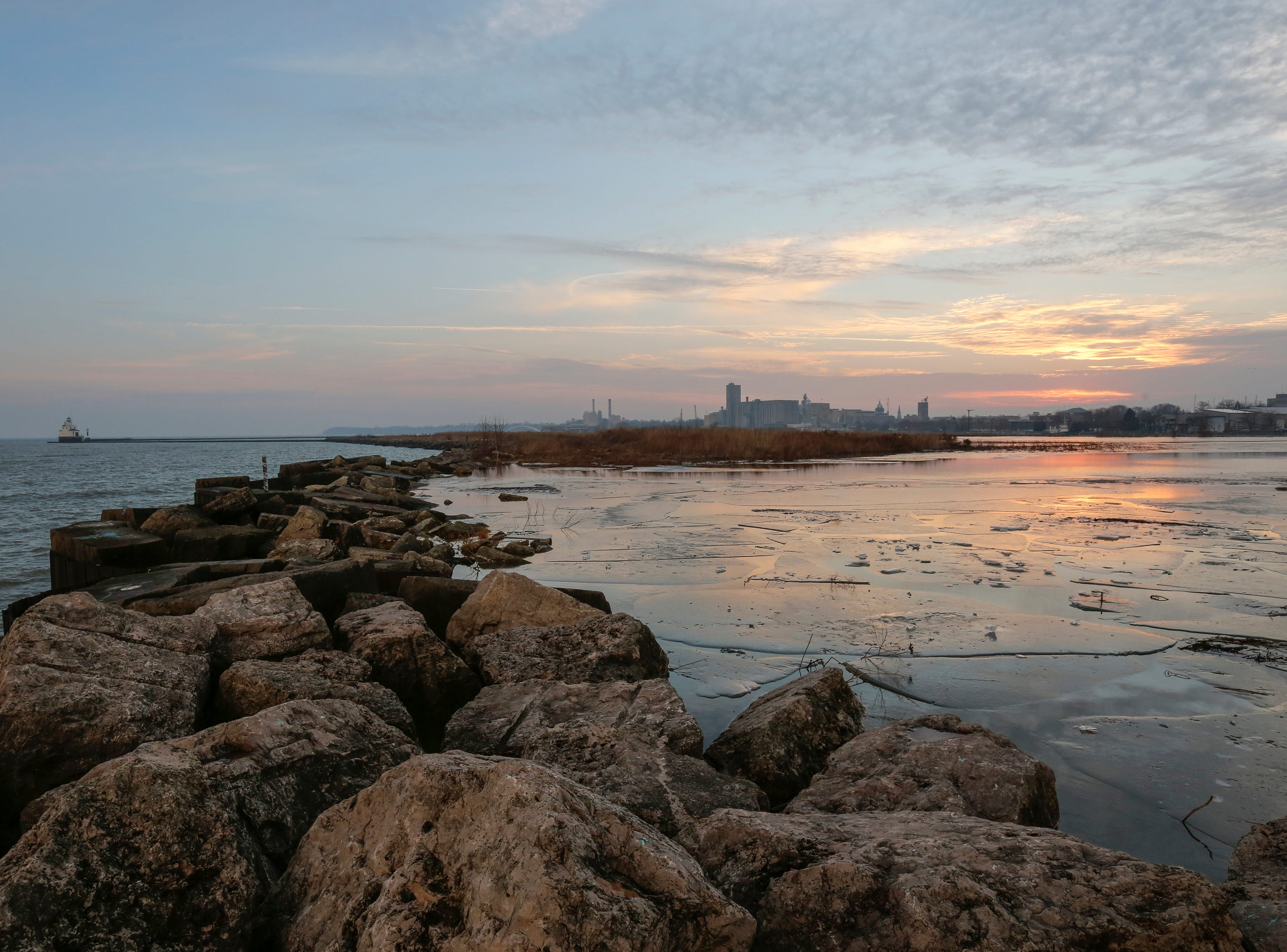 Clouds parted for a sunset over the harbor and downtown Thursday, December 13, 2018, in Manitowoc, Wis. Joshua Clark/USA TODAY NETWORK-Wisconsin