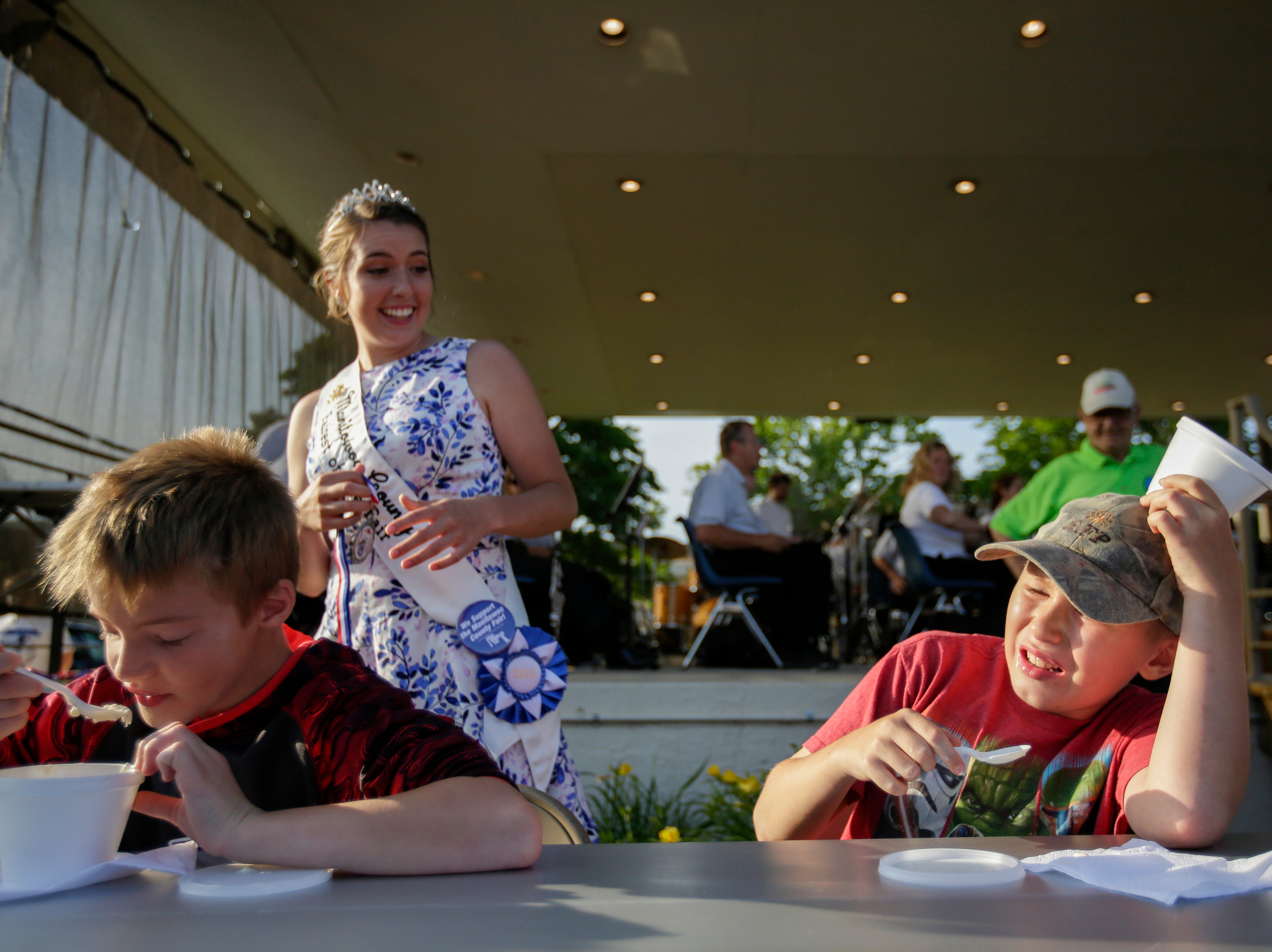 Mark Brinkman, 12, fights off a brain freeze after finishing first in the ice cream sundae eating contest during Sundae Thursday at Central Park Thursday, June 28, 2018, in Two Rivers, Wis. Josh Clark/USA TODAY NETWORK-Wisconsin