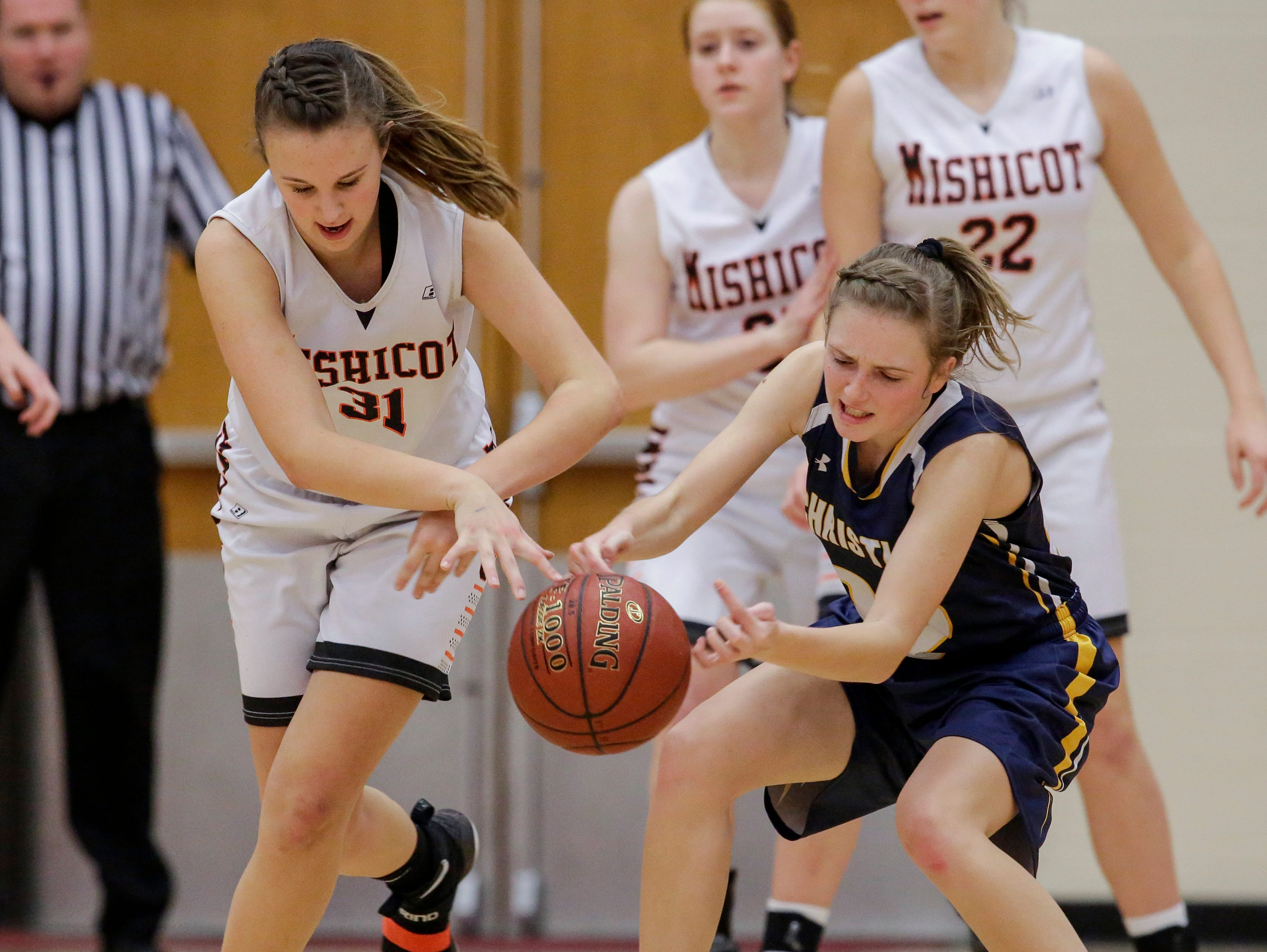 Mishicot's Kylie Schmidt (31) makes a steal against Sheboygan Christian at Mishicot High School Thursday, Jan. 18, 2018, in Mishicot, Wis. Josh Clark/USA TODAY NETWORK-Wisconsin