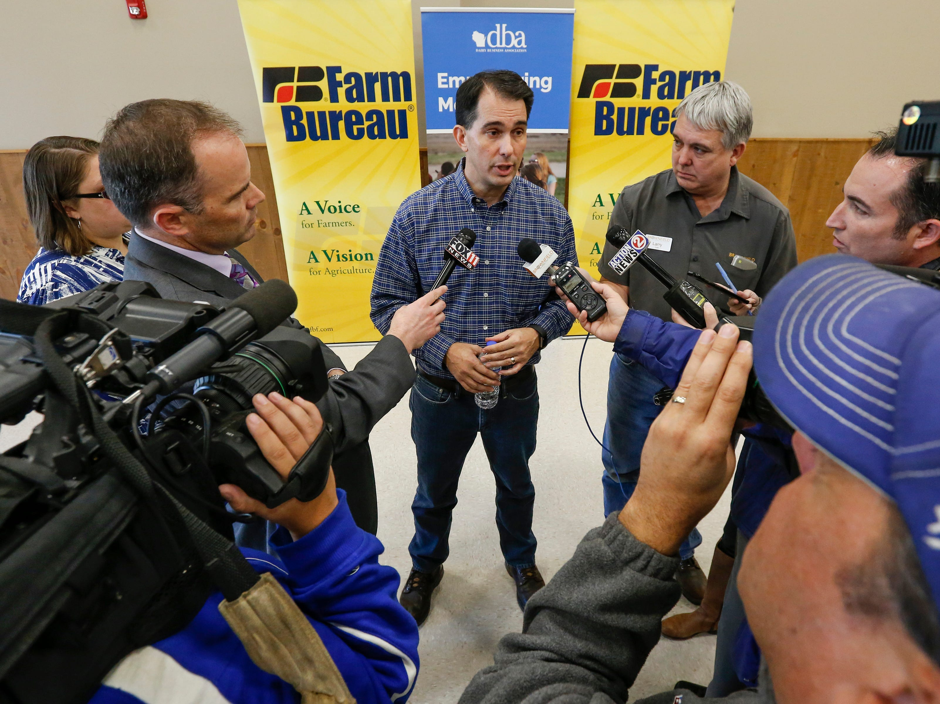 Governor Scott Walker answers reporters questions after receiving endorsements from Wisconsin agricultural groups at the Farm Wisconsin Discovery Center Thursday, October 18, 2018, in Manitowoc, Wis. Joshua Clark/USA TODAY NETWORK-Wisconsin