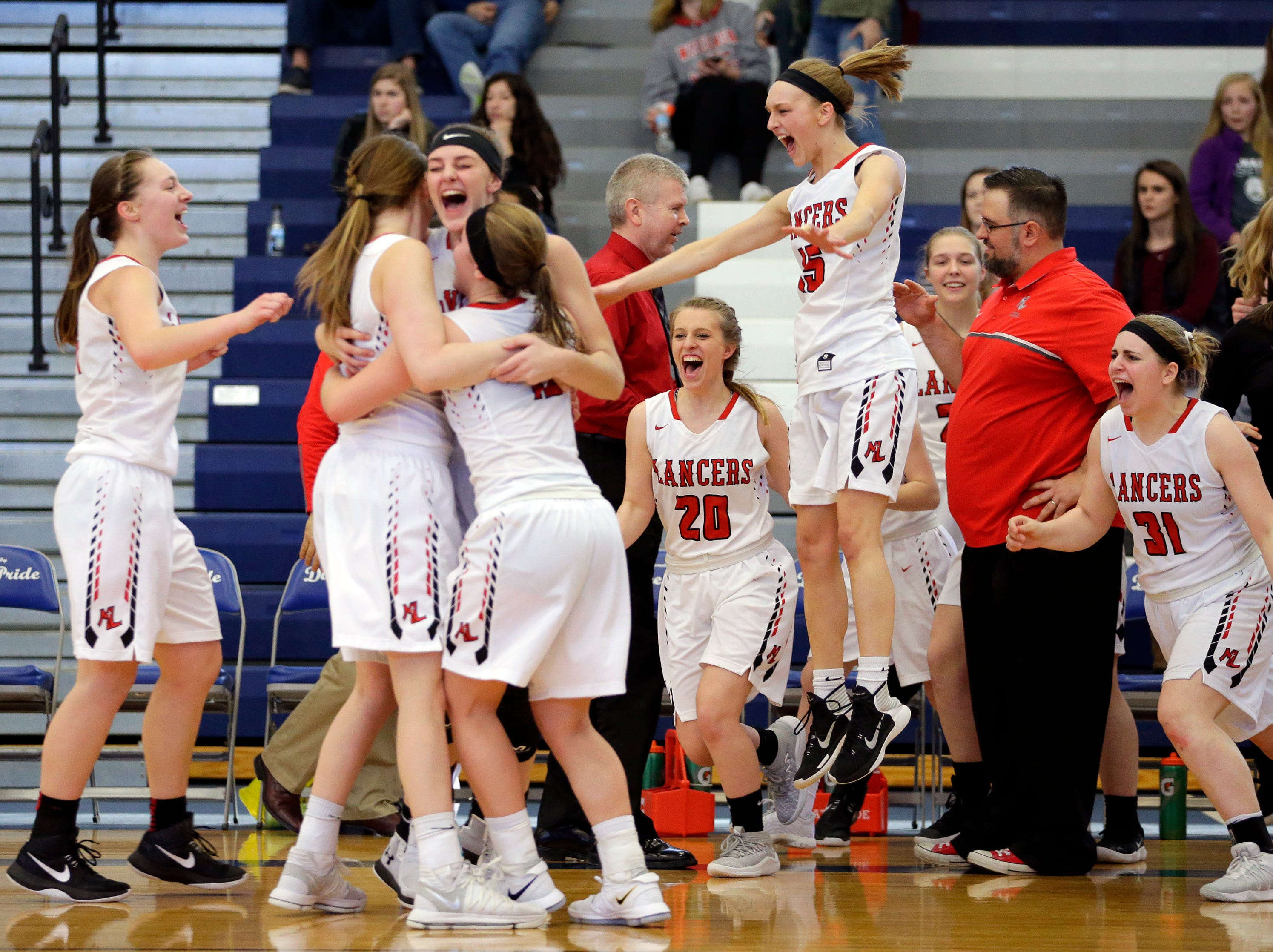 Manitowoc Lutheran's girls basketball team celebrates winning their D4 sectional championship against Milwaukee Academy of Science at Whitefish Bay High School Saturday, Mar. 3, 2018, in Whitefish Bay, Wis. Josh Clark/USA TODAY NETWORK-Wisconsin