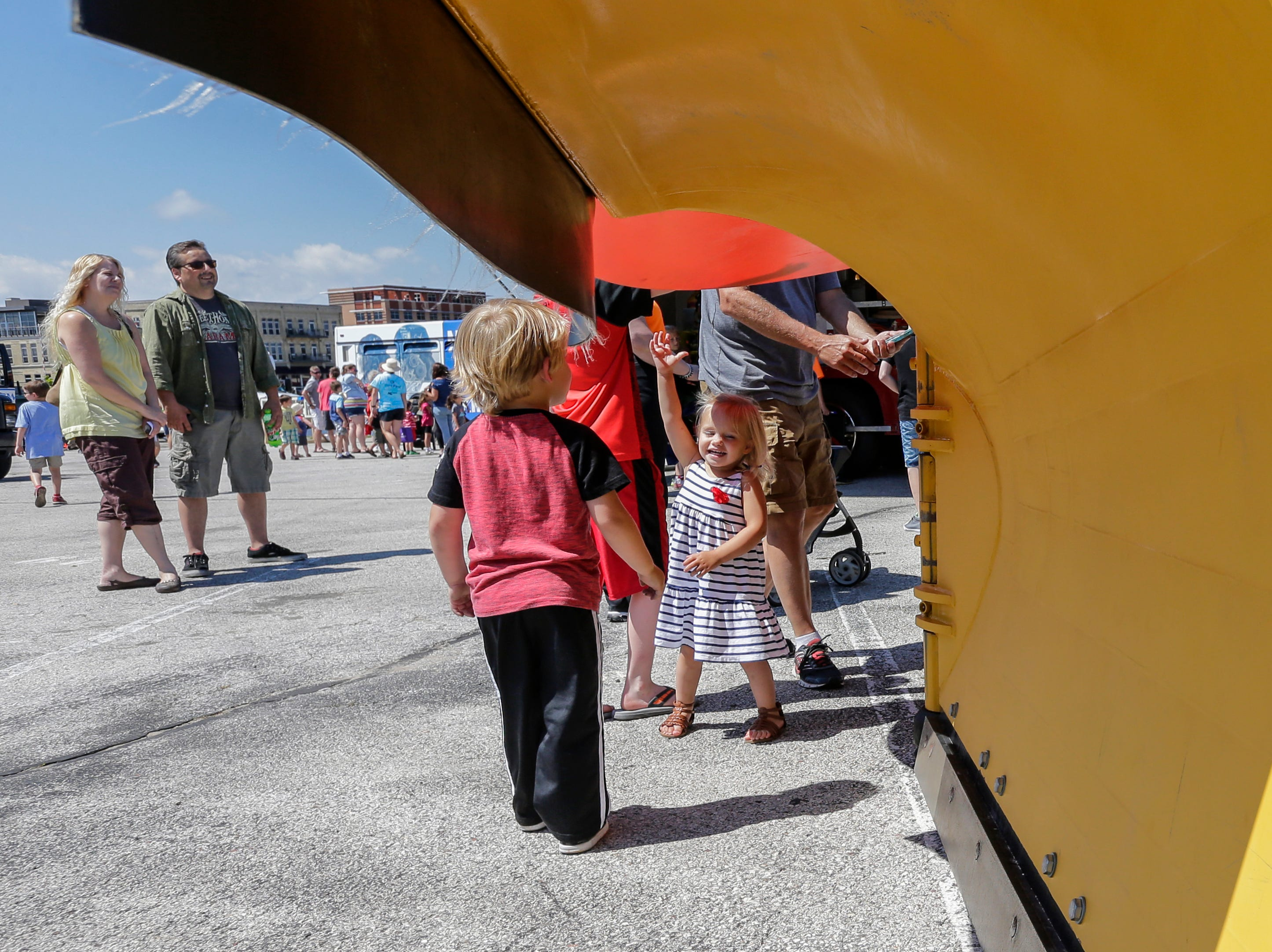 Chloe Derby, 2, tries to touch the top of the city's snow plow during the Touch the Trucks event put on by the library's children's service department Wednesday, July 18, 2018, in Manitowoc, Wis. Josh Clark/USA TODAY NETWORK-Wisconsin