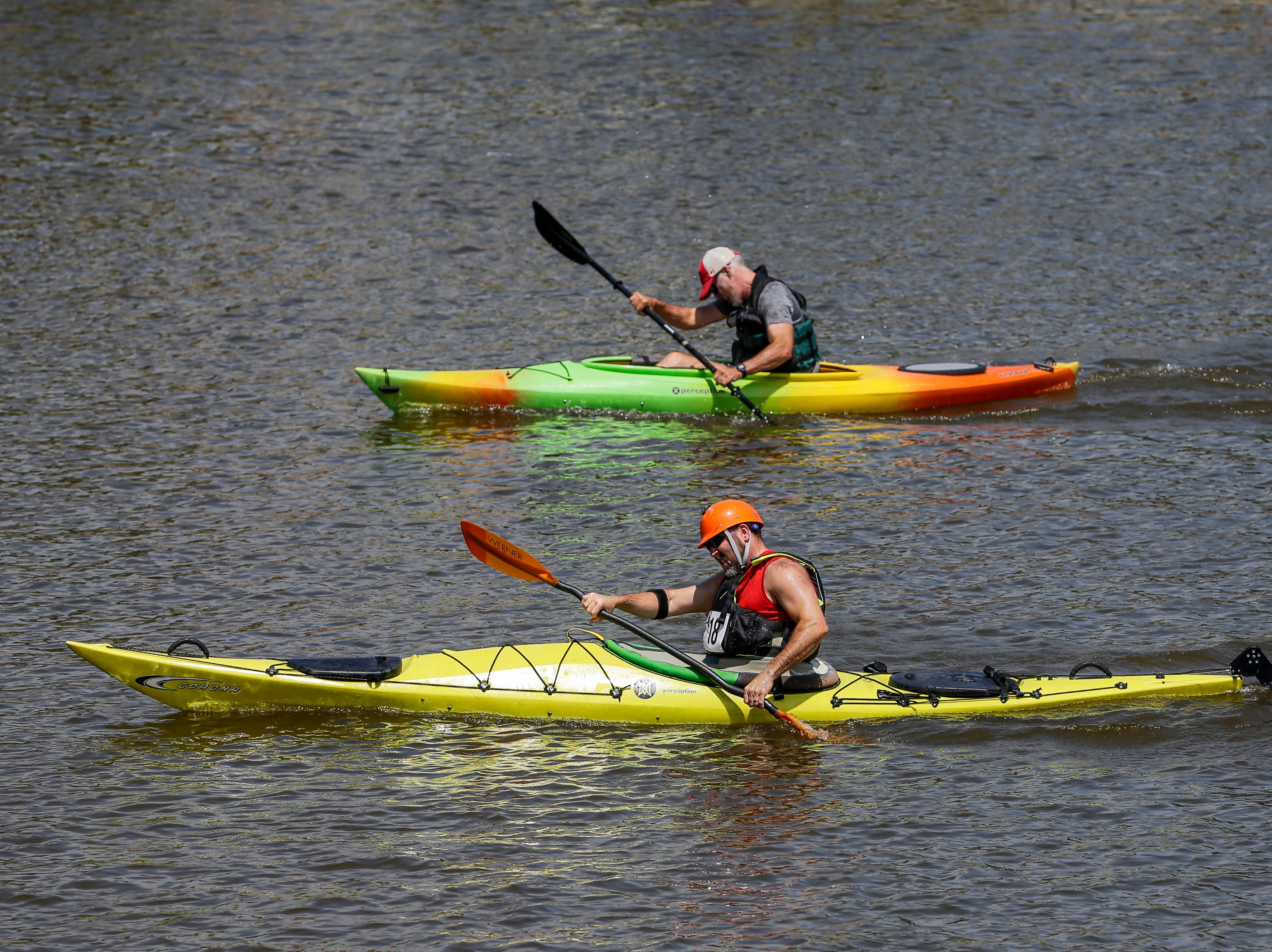 Two men battle it out in the last stretch of a kayak race on the Manitowoc River during Subfest Saturday, July 14, 2018, in Manitowoc, Wis. Josh Clark/USA TODAY NETWORK-Wisconsin