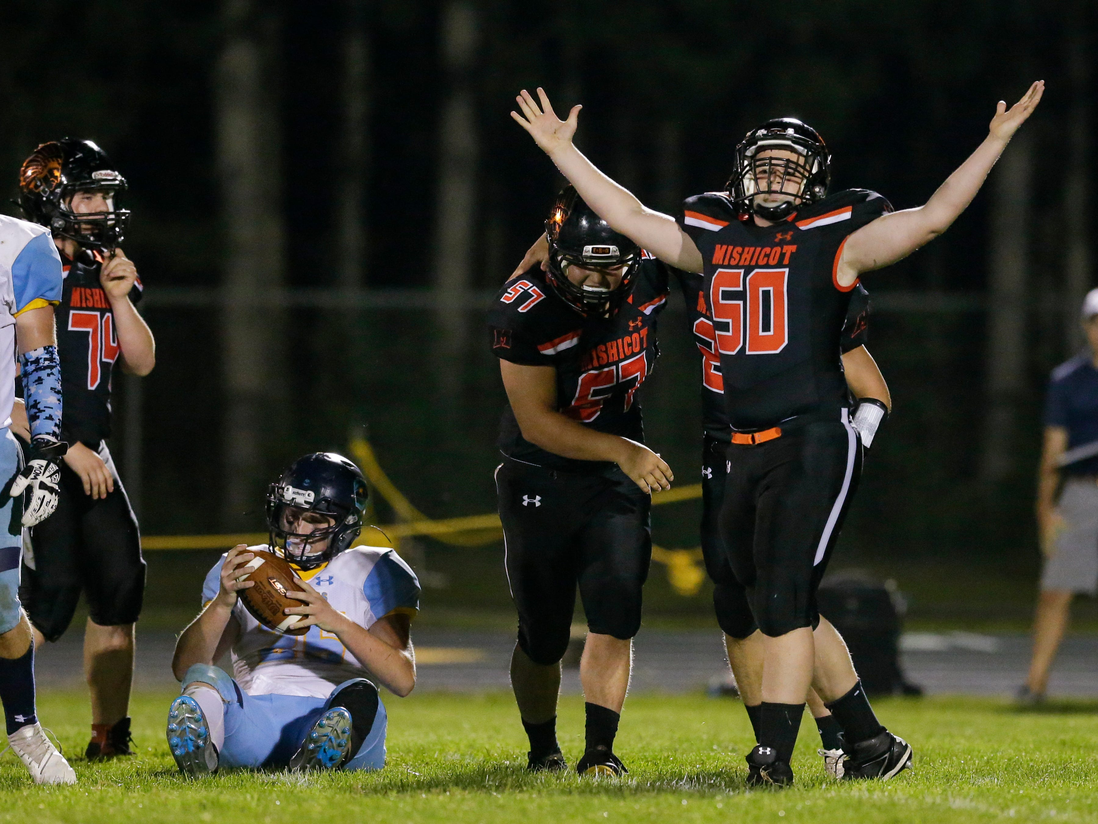 Mishicot's Ethan Brossard (50) reacts after sacking St. Mary Catholic's Logan Groebner (25) during a Big East Conference matchup at Mishicot High School Friday, August 31, 2018, in Mishicot, Wis. Josh Clark/USA TODAY NETWORK-Wisconsin