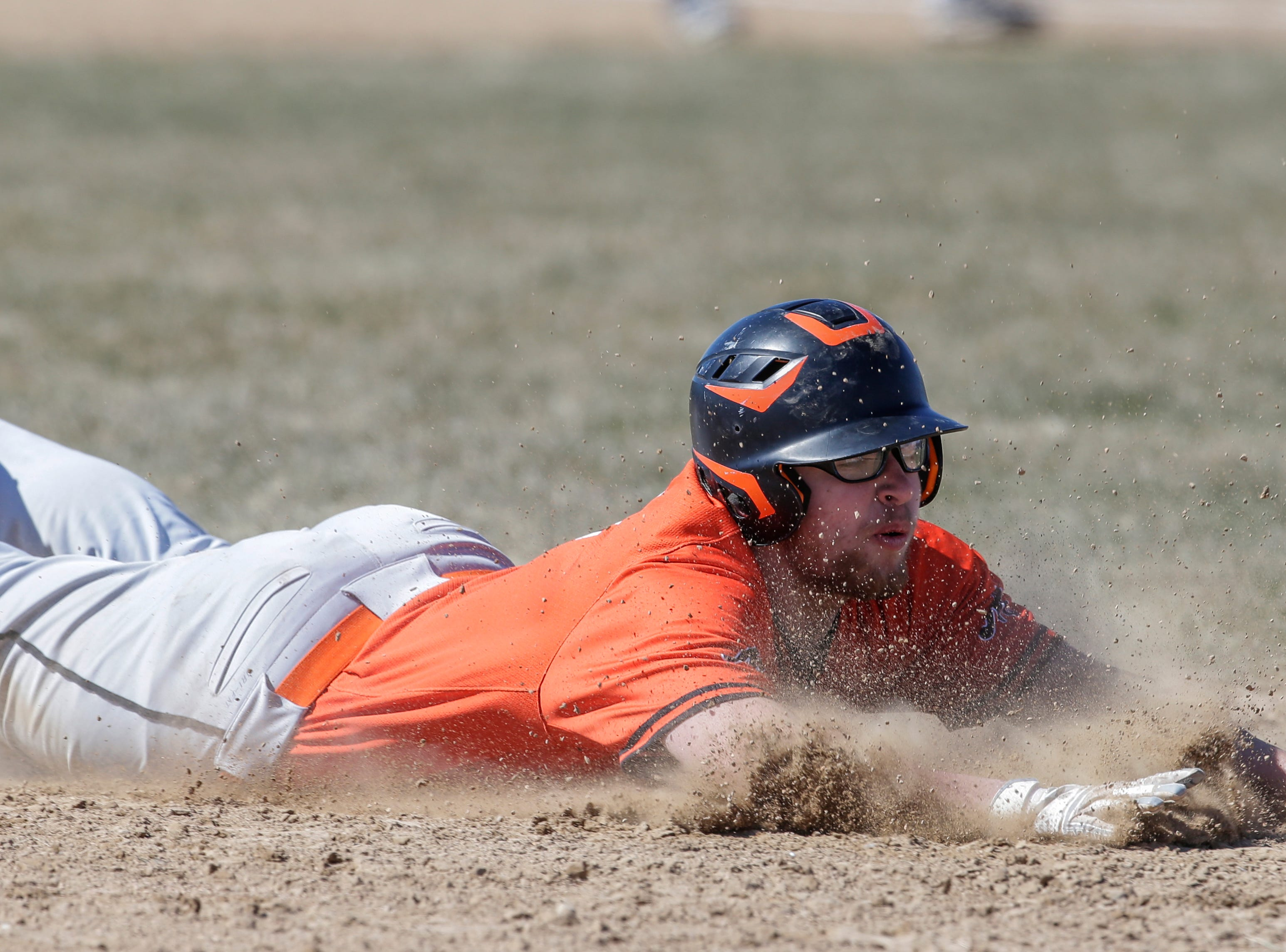 Mishicot's Austin Lambrecht (6) slides into third base against Roncalli at Roncalli High School Saturday, Apr. 28, 2018, in Manitowoc, Wis. Josh Clark/USA TODAY NETWORK-Wisconsin