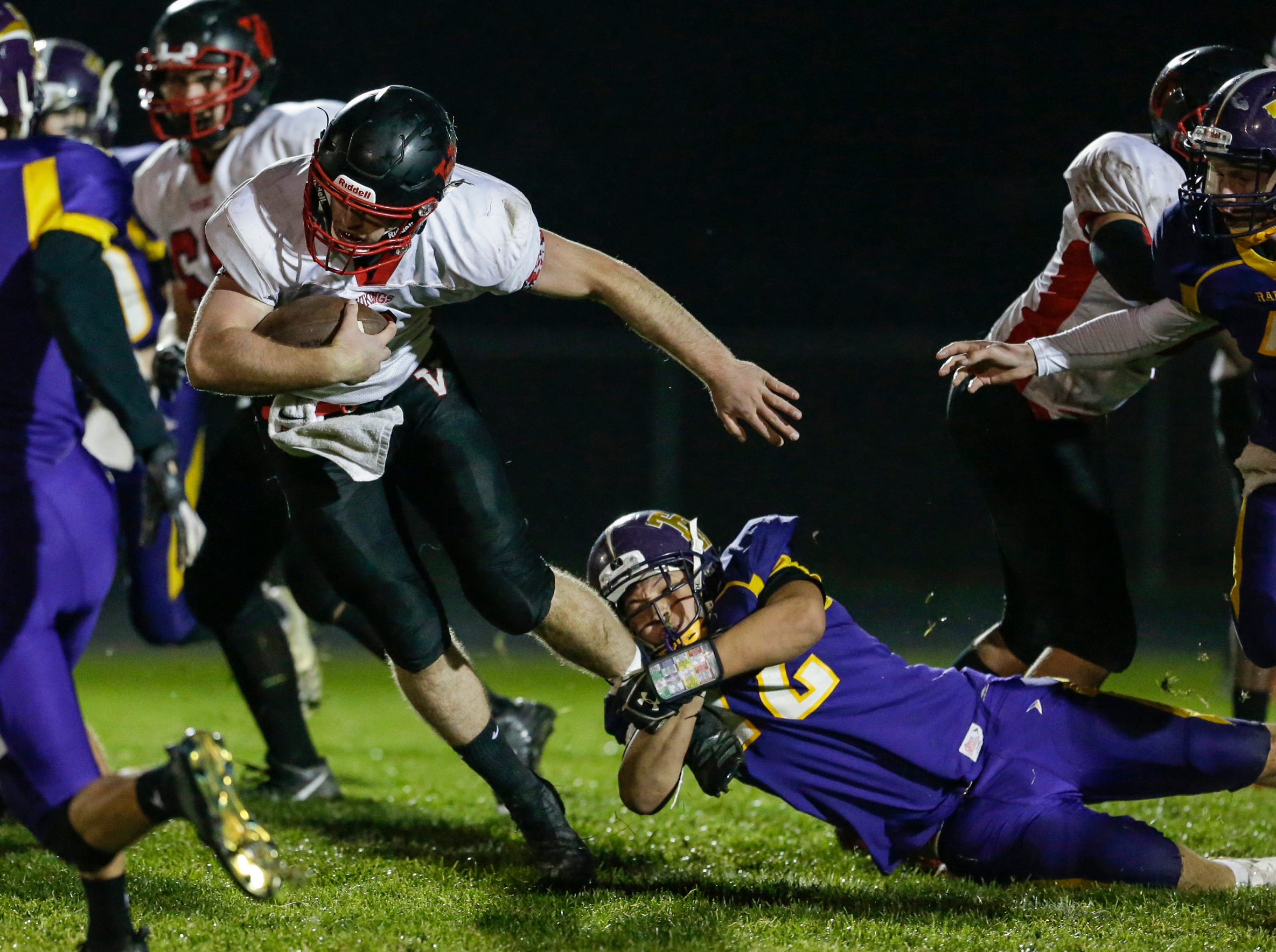 Two Rivers' Anderson Kopidlansky (72) tackles Valders' Fletcher Dallas (2) during an Eastern Wisconsin Conference game at Two Rivers High School Friday, October 5, 2018, in Two Rivers, Wis. Joshua Clark/USA TODAY NETWORK-Wisconsin
