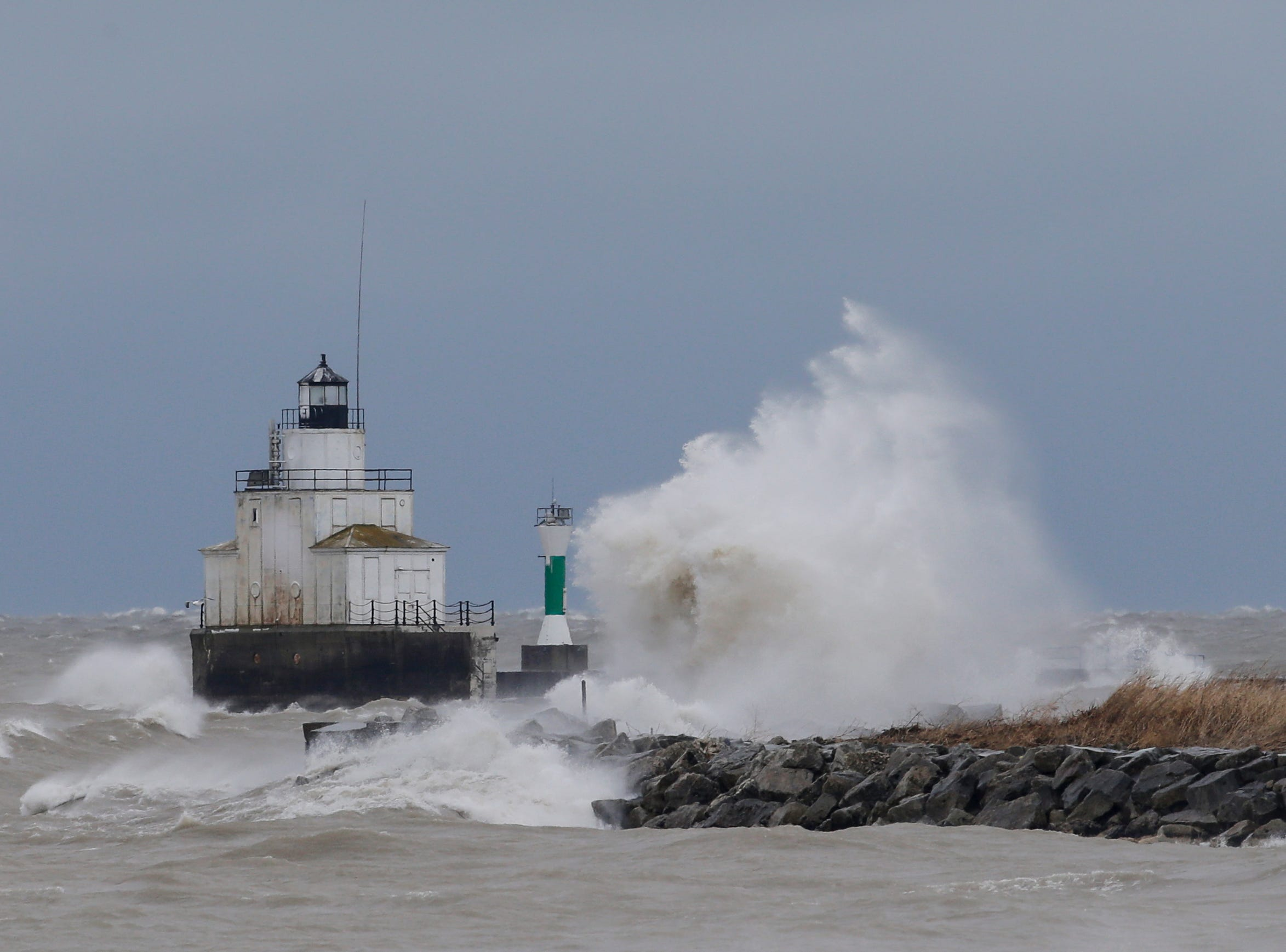 Waves crash against a breakwall along the Lake Michigan shoreline during a winter storm Saturday, Apr. 14, 2018, in Manitowoc, Wis. Josh Clark/USA TODAY NETWORK-Wisconsin