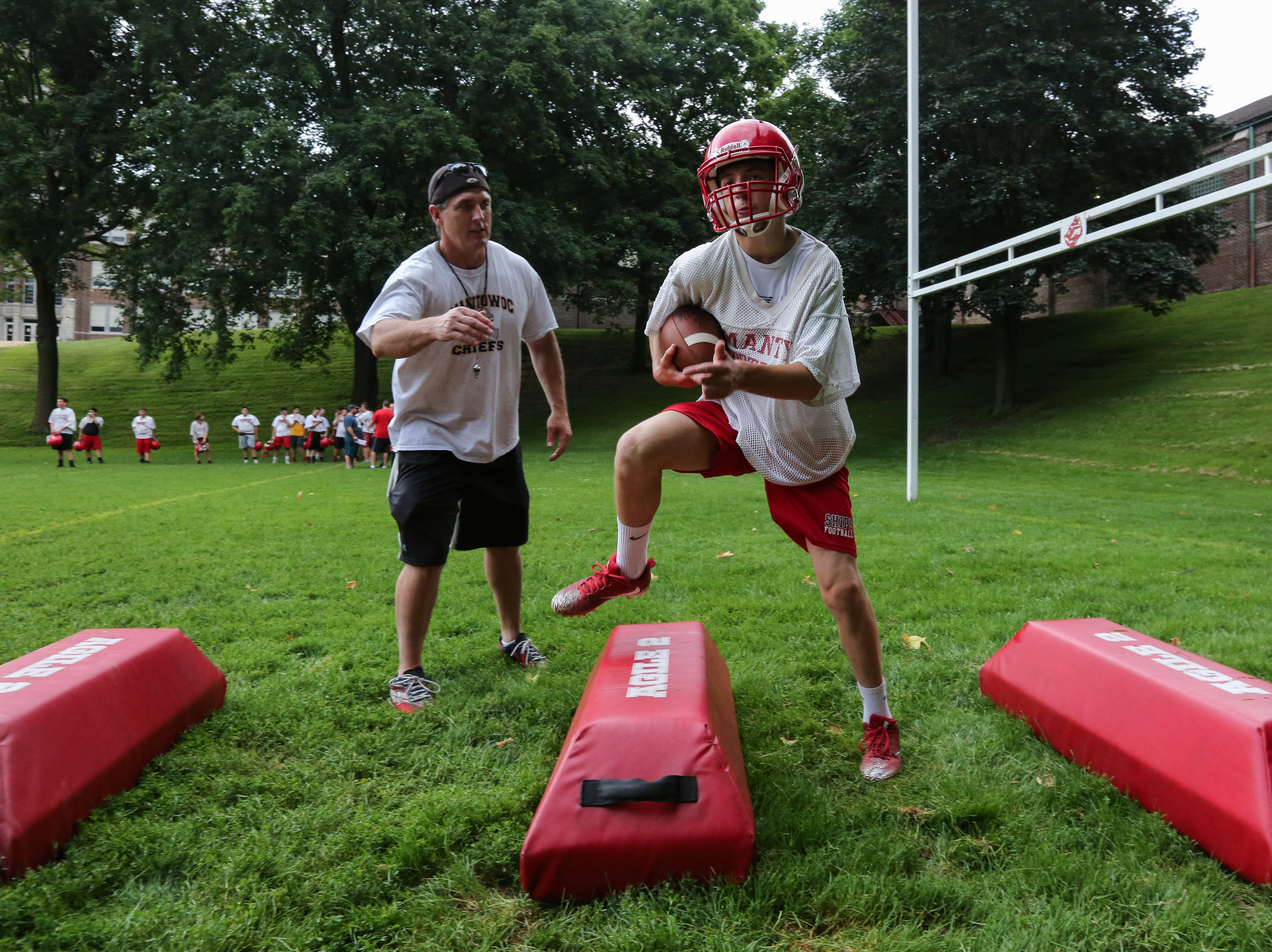 Lincoln's Ethan Riske, right, does an agility drill during the Ships' first football practice of the season at Manitowoc Lincoln High School Wednesday, August 1, 2018, in Manitowoc, Wis. Josh Clark/USA TODAY NETWORK-Wisconsin
