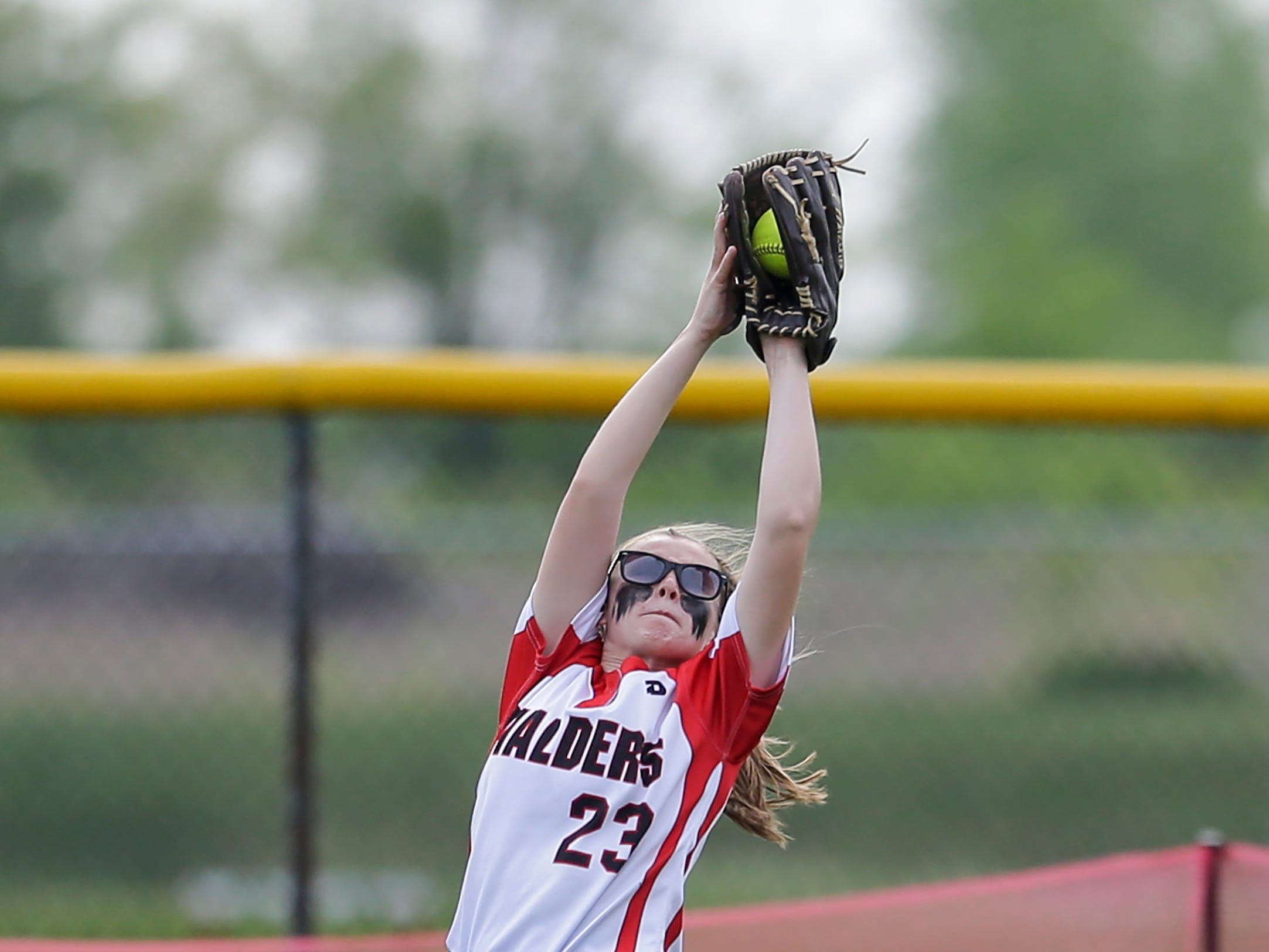 Valders' Madison Sabel (23) jumps to catch a fly ball against Southern Door during the WIAA D3 softball regional championship game at Valders High School Friday, May 25, 2018, in Valders, Wis. Josh Clark/USA TODAY NETWORK-Wisconsin