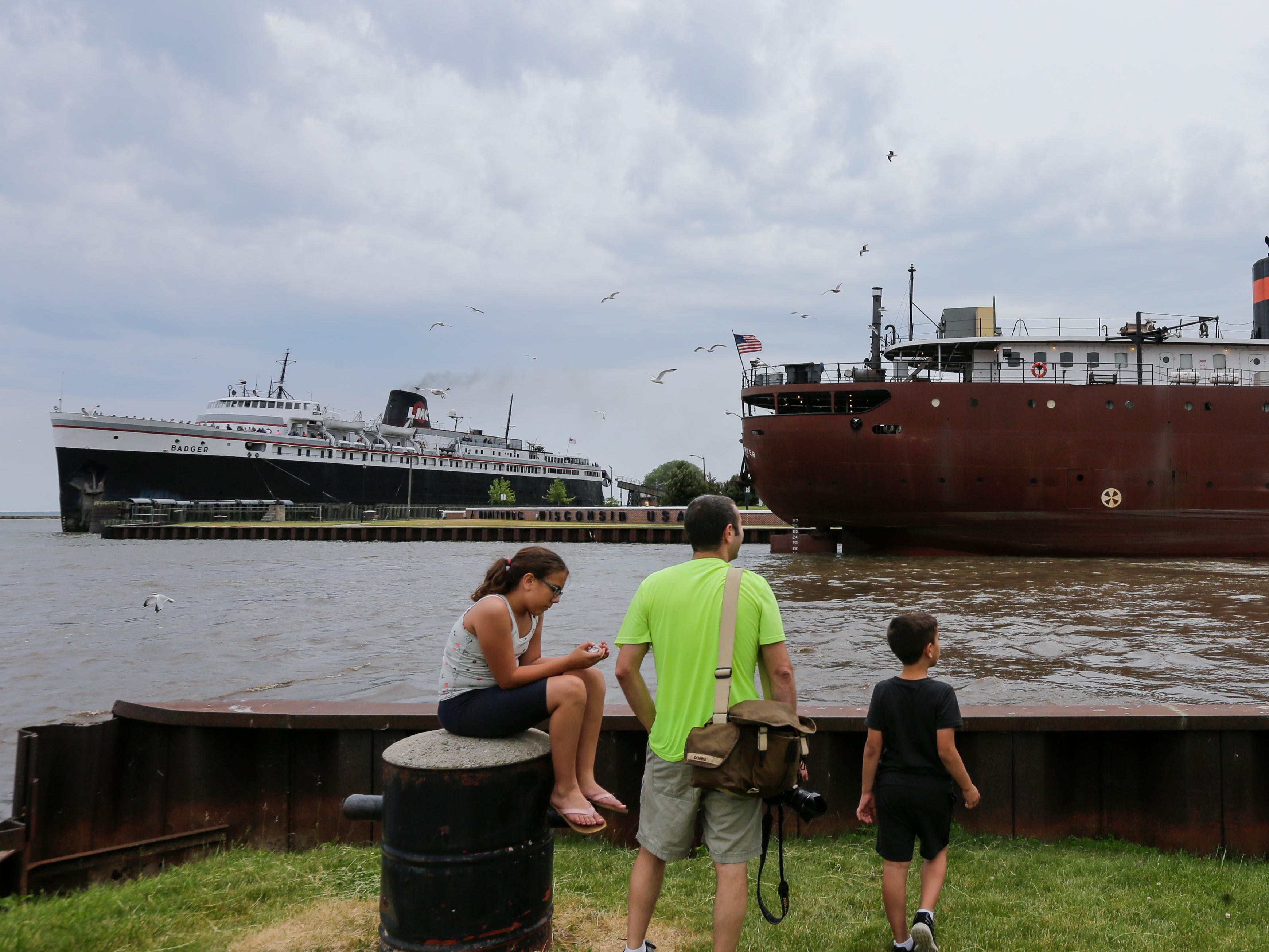 People watch as the lake vessel Kaye E. Barker delivers a load of coal for Manitowoc Public Utilities Saturday, Jun 16, 2018, in Manitowoc, Wis. The Barker, built in 1952 as the Edward B. Greene, is more than 700 feet long and can carry 25,900 gross tons of cargo. Josh Clark/USA TODAY NETWORK-Wisconsin