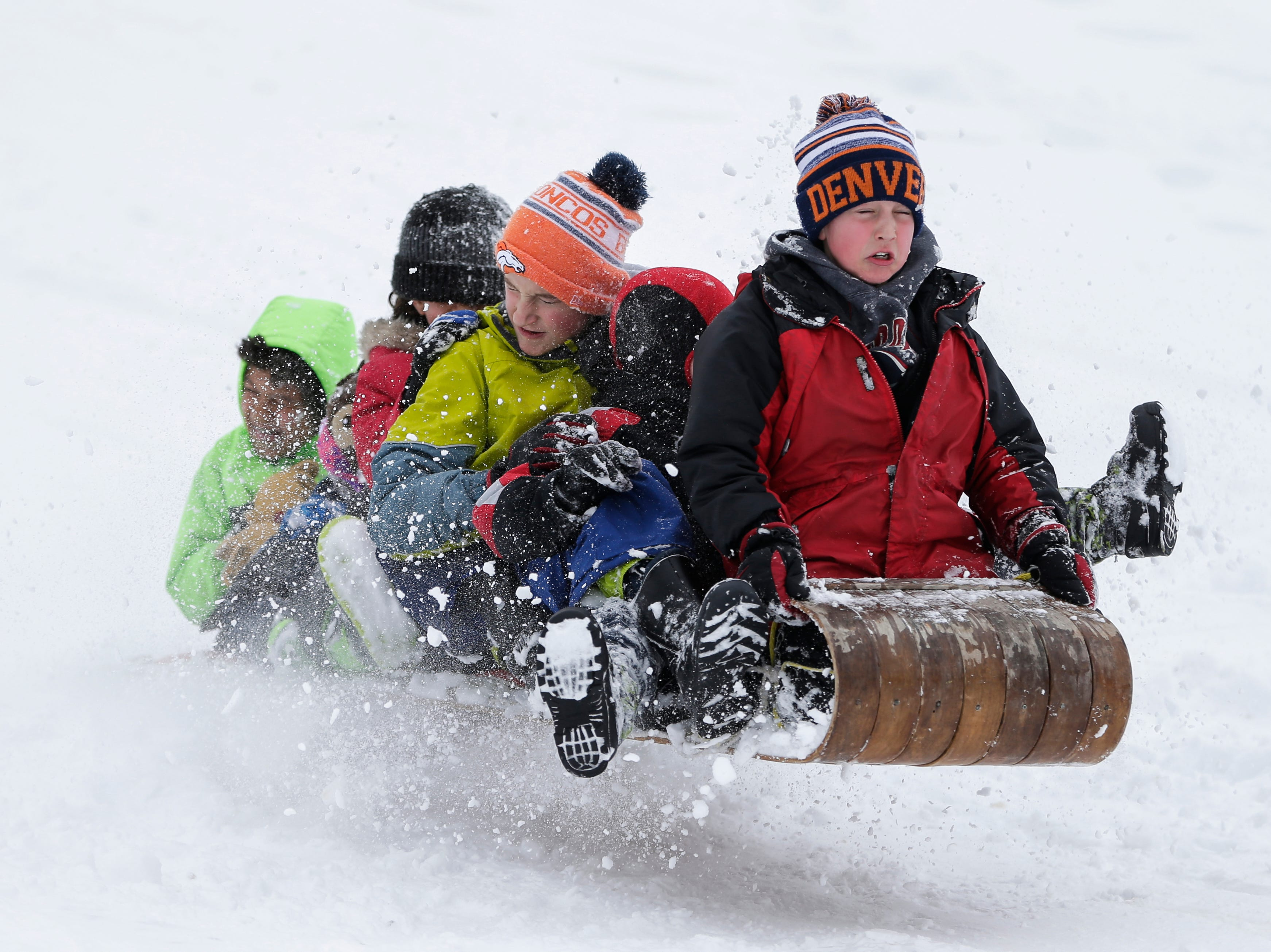 Chase Crees, 9, of Manitowoc, steers a toboggan full of his friends over a jump on the hill at Silver Creek Park Monday, Apr. 16, 2018, in Manitowoc, Wis. Children were given the day off of school after winter storm Evelyn brought a mess of snow to the area. Josh Clark/USA TODAY NETWORK-Wisconsin