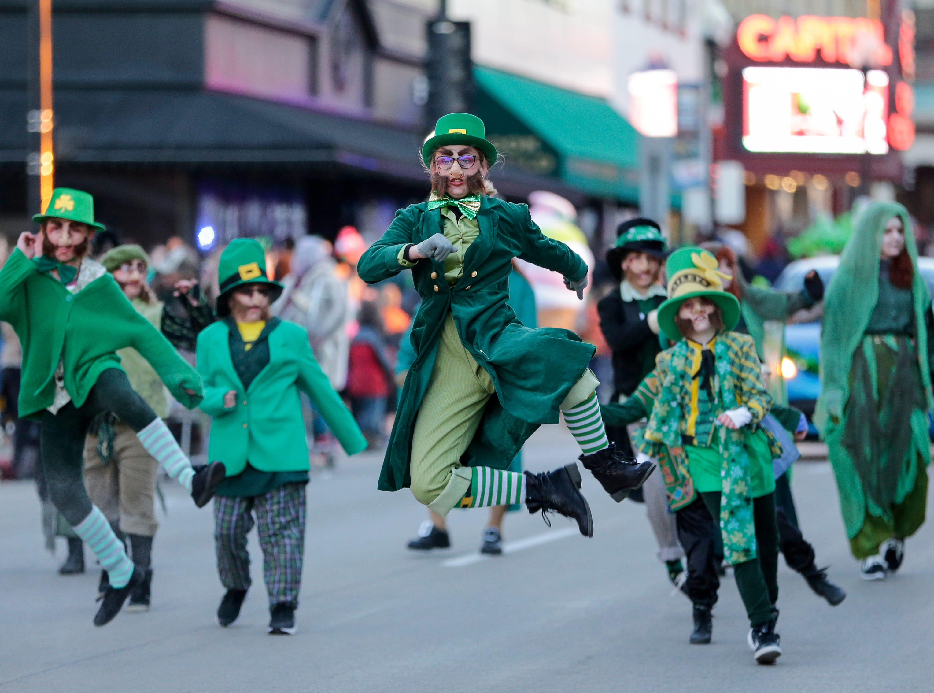 Manitowoc dancers leap on 8th Street during the St. Patrick's Day parade Saturday, Mar. 17, 2018, in Manitowoc, Wis. Josh Clark/USA TODAY NETWORK-Wisconsin