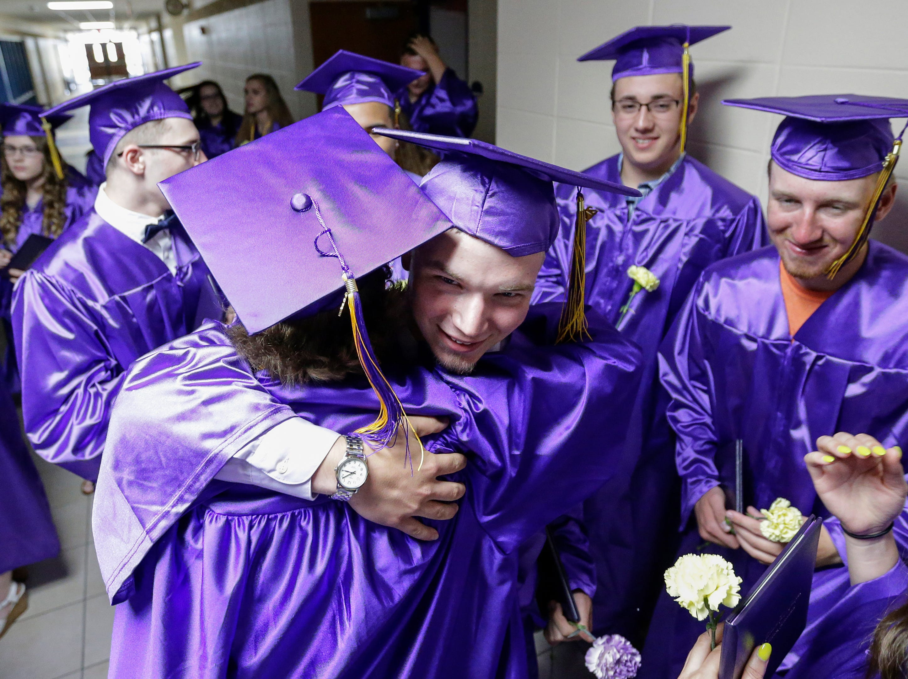 Alex Richmond hugs his fellow graduates after the graduation ceremony at Two Rivers High School Saturday, Jun 9, 2018, in Two Rivers, Wis. Josh Clark/USA TODAY NETWORK-Wisconsin