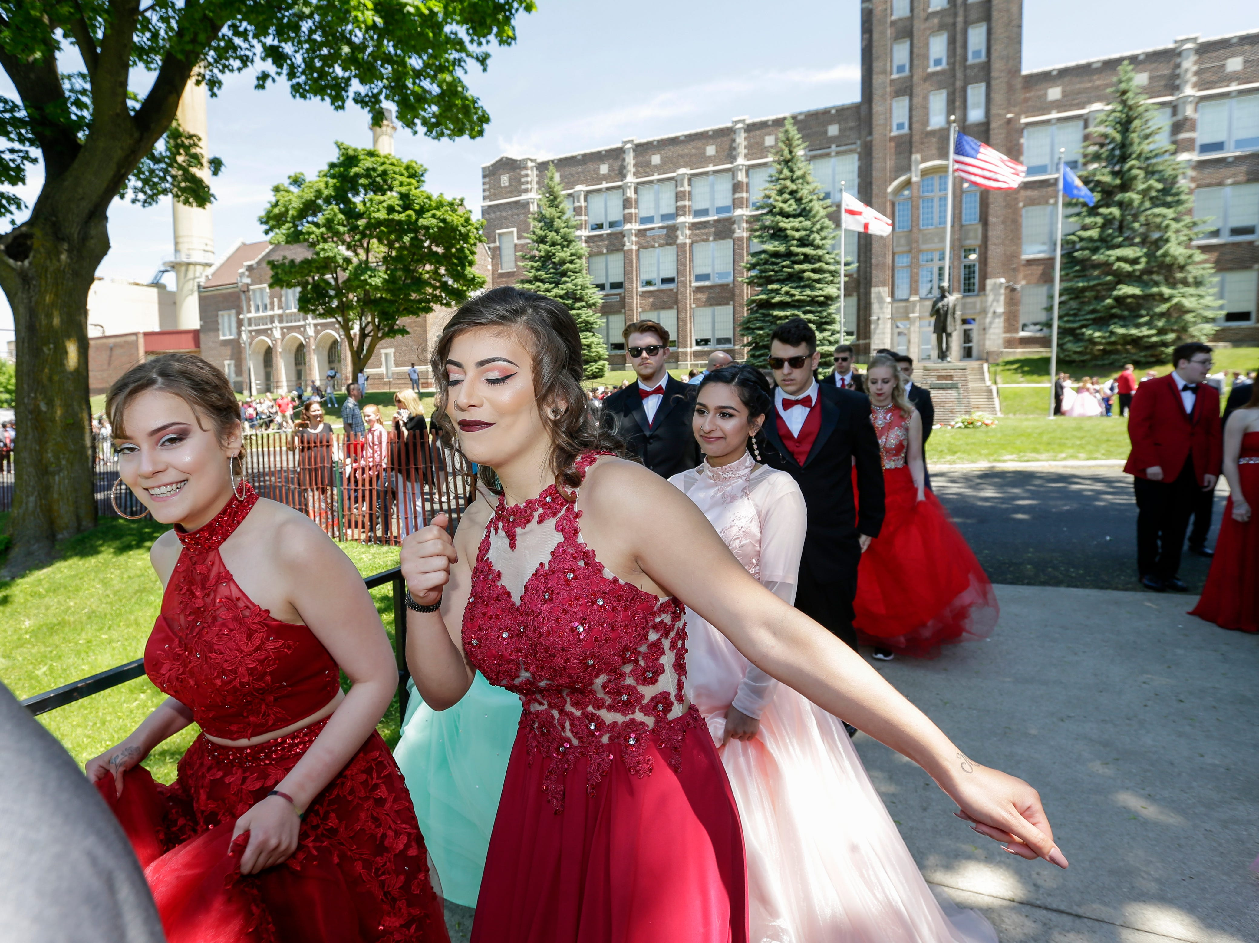 Cheyene Medina, left, and her sister Lydia Medina dance down the stairs in the procession to the field for the graduation ceremony at Manitowoc Lincoln High School Friday, Jun 8, 2018, in Manitowoc, Wis. Josh Clark/USA TODAY NETWORK-Wisconsin