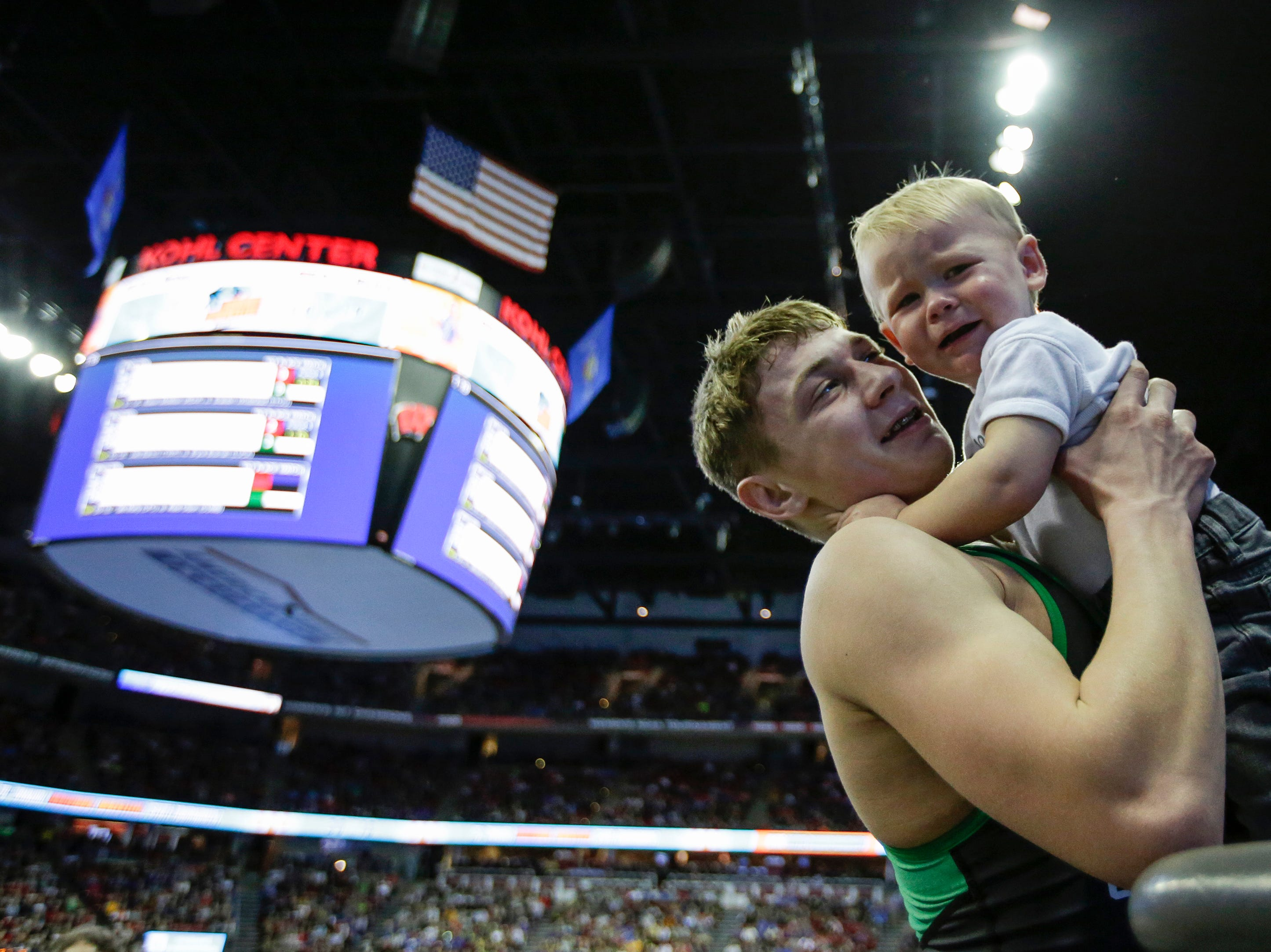Coleman's Caleb Gross celebrates his win with his baby brother in the D3 120 pound championship during the WIAA Individual Wrestling State Tournament at the Kohl Center Saturday, Feb. 24, 2018, in Madison, Wis. Josh Clark/USA TODAY NETWORK-Wisconsin