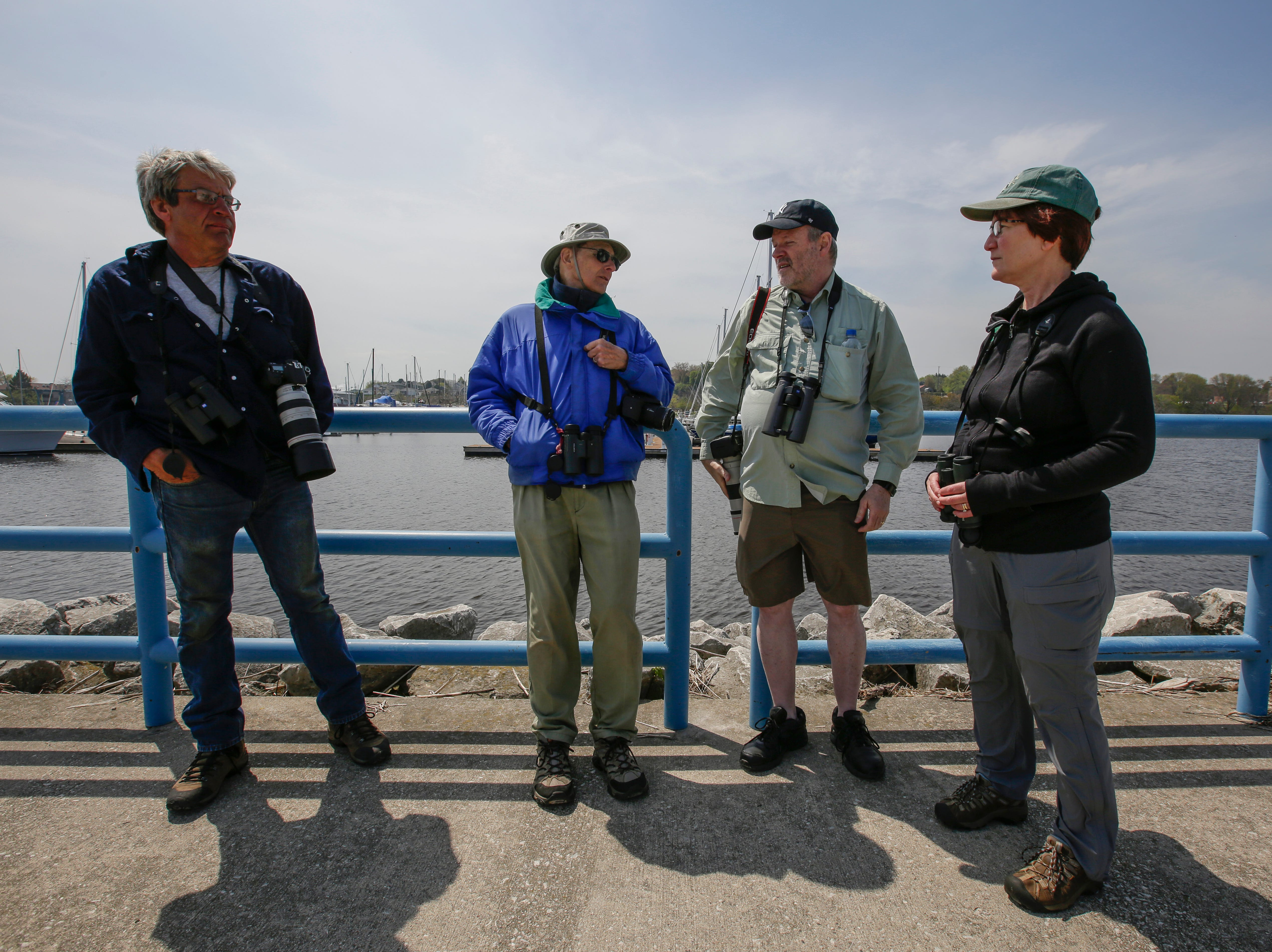 UW-Manitowoc professor emeritus Chuck Sontag, center left, shares his knowledge of shorebirds with other birders visiting the containment area along Lake Michigan Thursday, May 24, 2018, in Manitowoc, Wis. Sontag has recorded more than 300 species of birds along the lakeshore since he began birding the area. His dedication and enthusiasm has helped turn the Manitowoc lakeshore into a destination for birders from all over the country. Josh Clark/USA TODAY NETWORK-Wisconsin