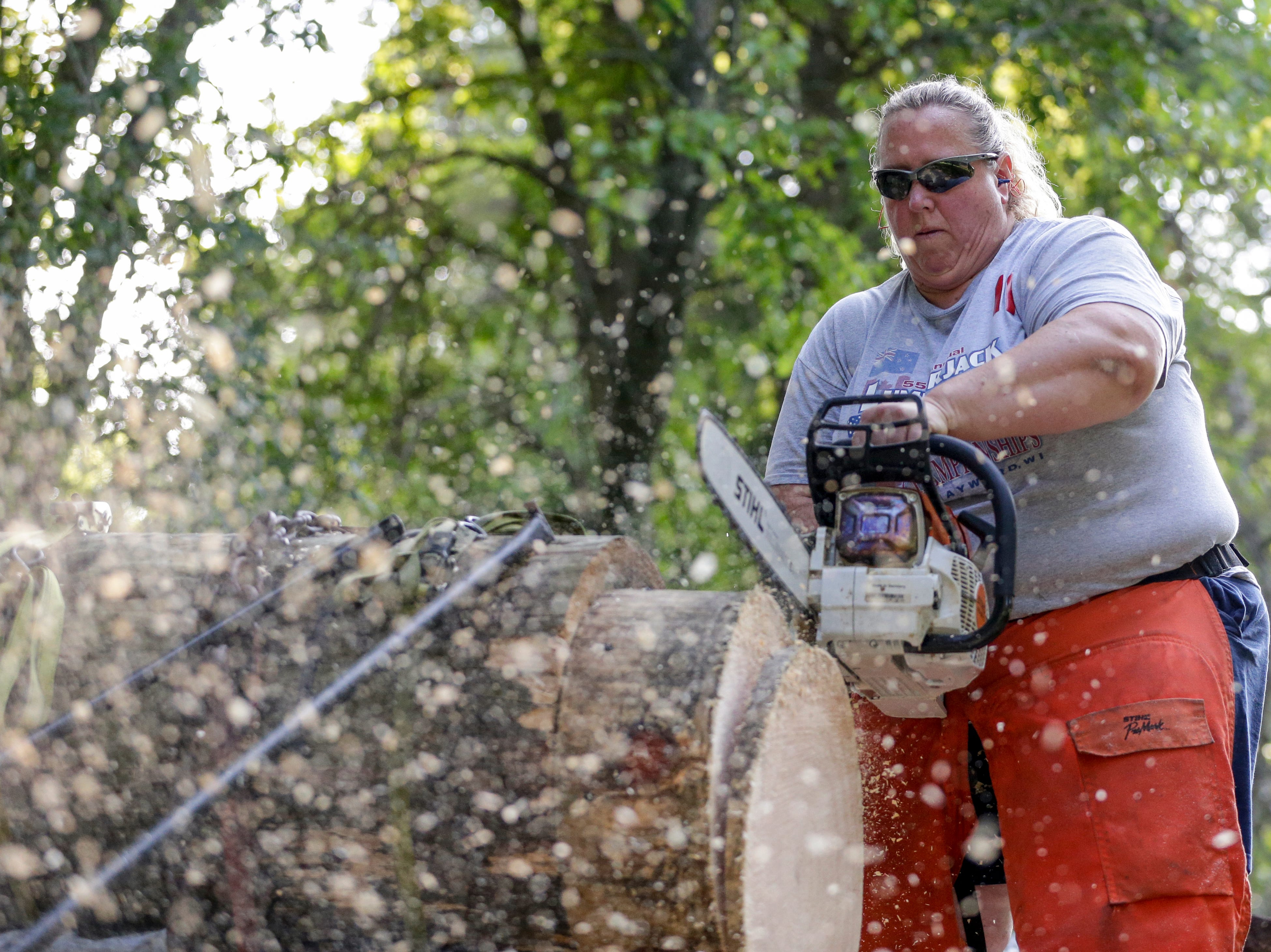 Nancy Zalewski practices her stock saw for an upcoming competition Thursday, August 9, 2018, in Manitowoc, Wis. Zalewski finished in third place at the 2018 Stihl Timbersports Women's Division Championship. Josh Clark/USA TODAY NETWORK-Wisconsin