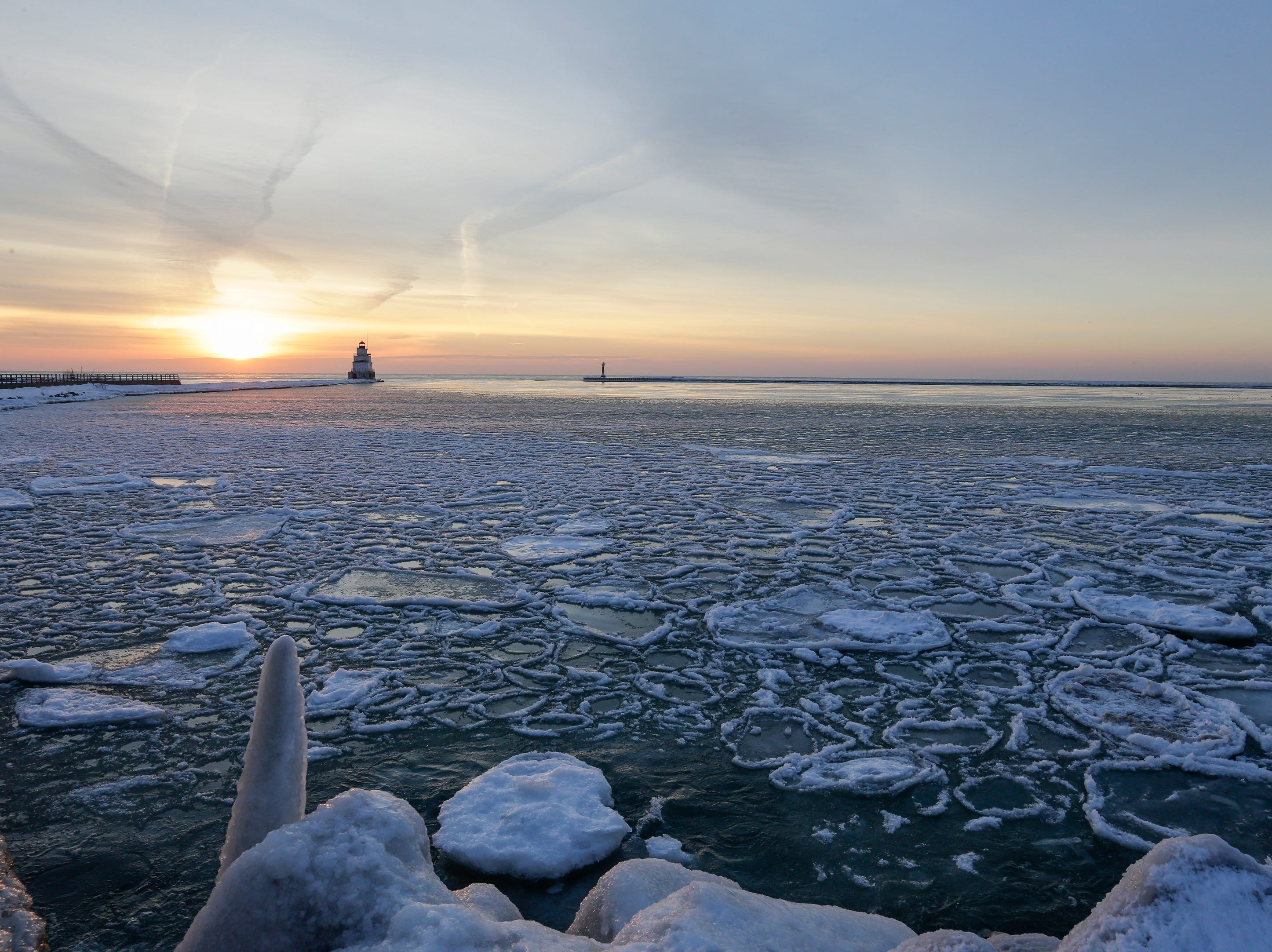 Pancake ice sits on top of Lake Michigan as the sun rises Friday, Jan. 19, 2018, in Manitowoc, Wis. Josh Clark/USA TODAY NETWORK-Wisconsin