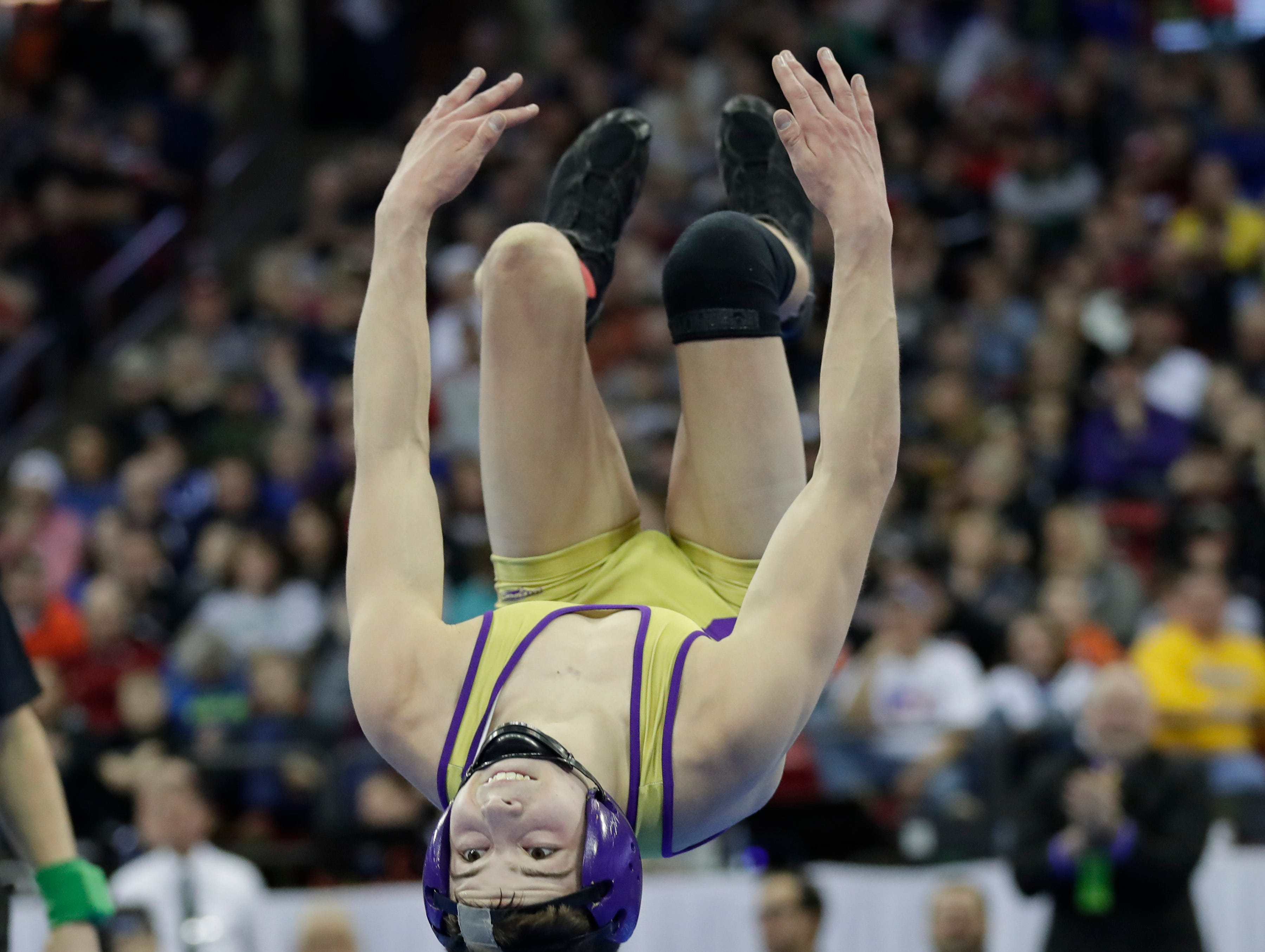 Matt Bianchi of Two Rivers backflips after beating Colby McHugh of Freedom in the 113 pound D2 finals at the 2018 State Individual Wrestling Tournament Finals Saturday, February 24, 2018 at the Kohl Center in Madison, Wis.