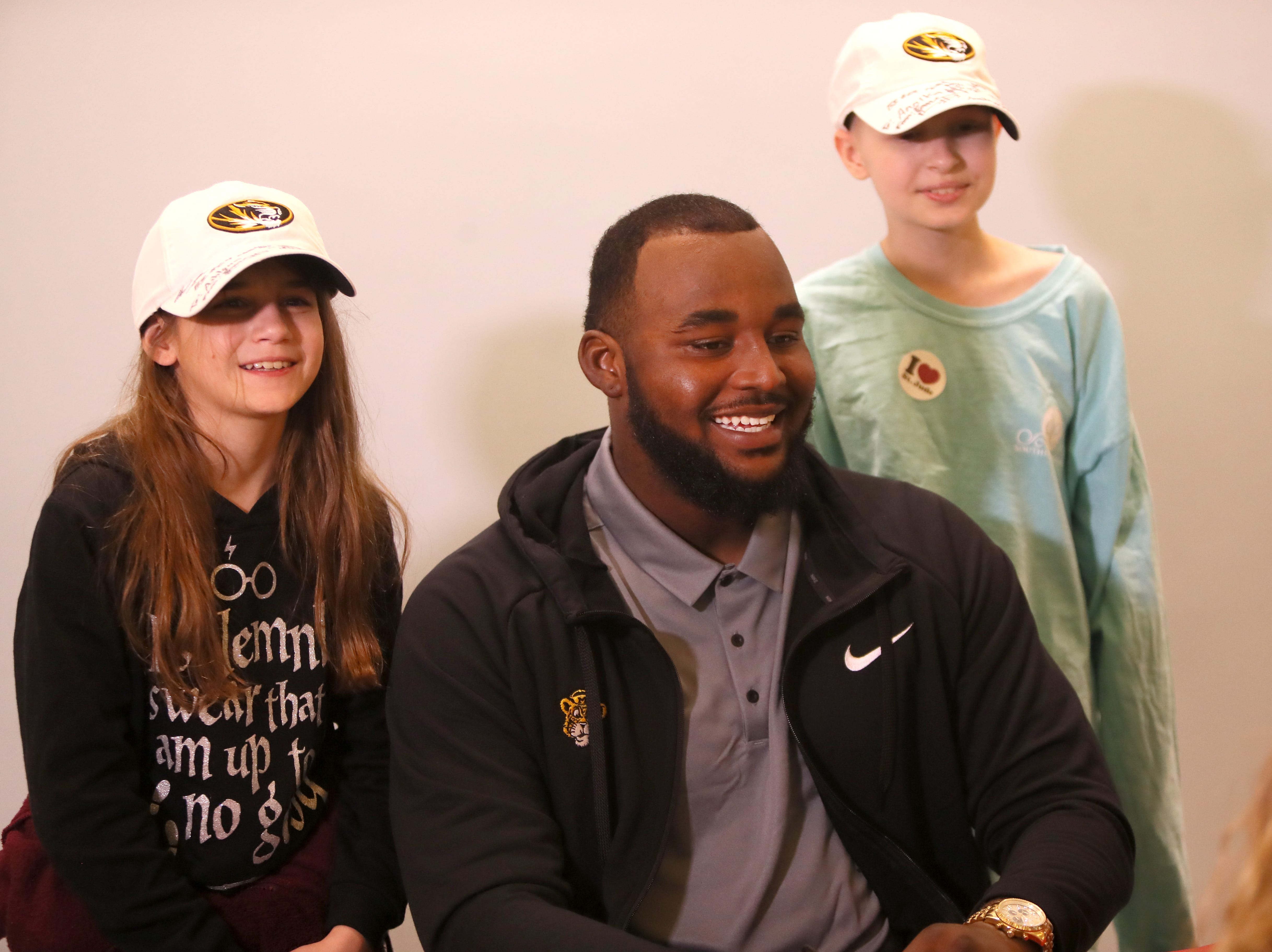 Missouri Tigers football team poses for photos with children at St. Jude Children's Research Hospital Friday as the players made a visit in a part of their tour of Memphis, before playing in Monday's Liberty Bowl.
