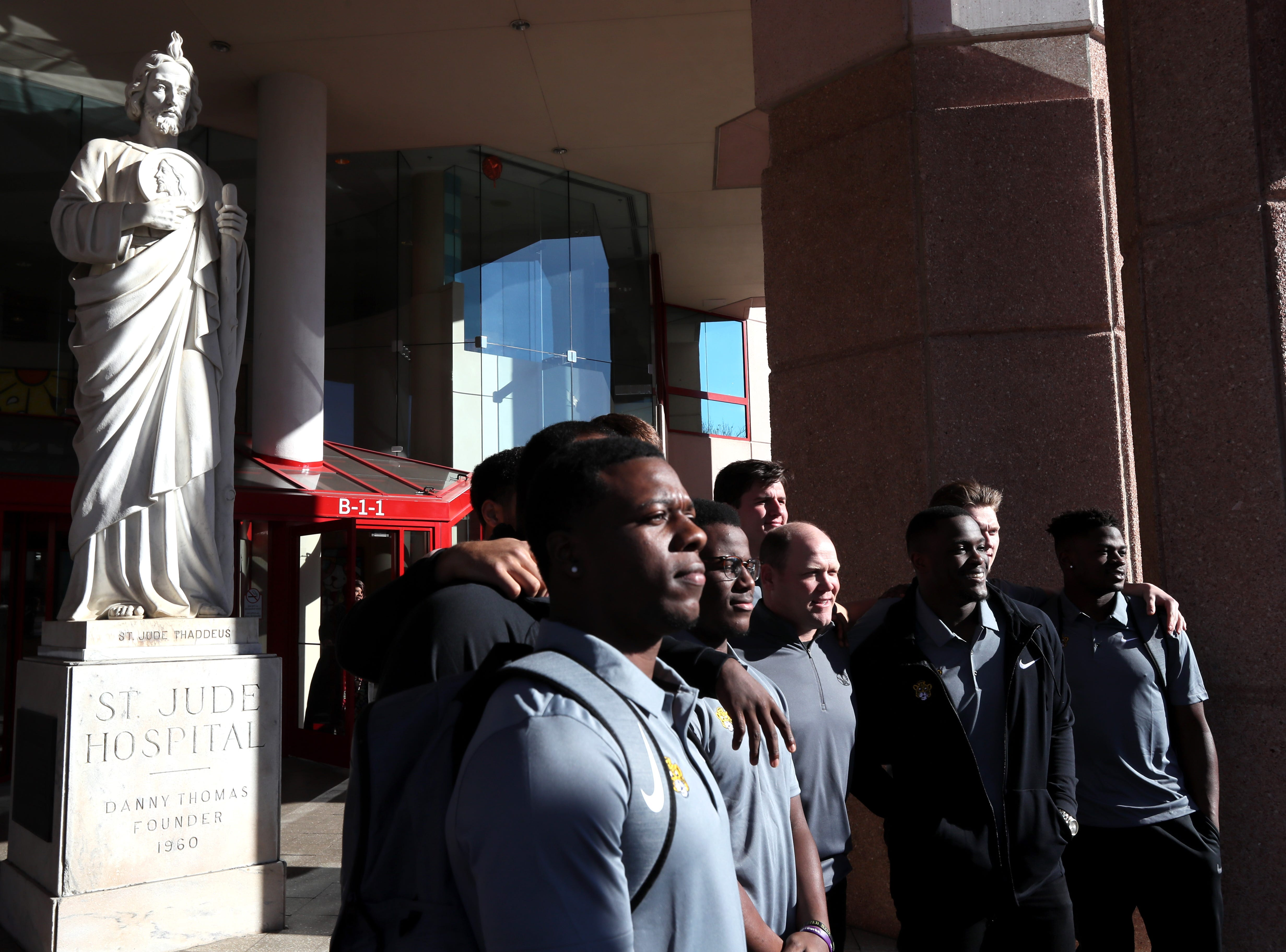 The Missouri Tigers football team poses for a photo outside of St. Jude Children's Research Hospital Friday as the players visited in part of their tour of Memphis, before playing in Monday's Liberty Bowl.