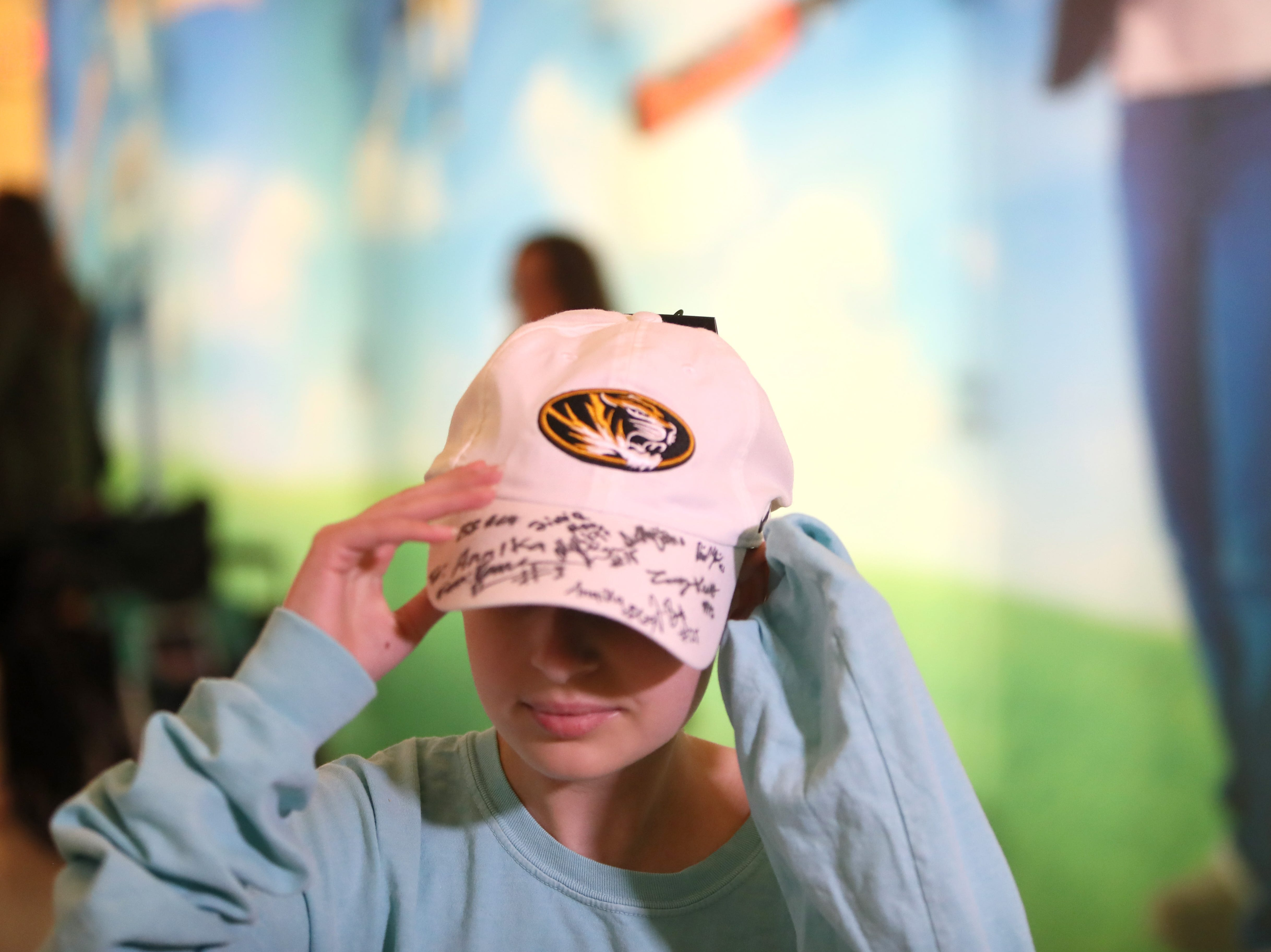 St. Jude patients get autographs from the Missouri Tigers football team Friday as the players made a visit to the hospital as a part of their tour of Memphis, before playing in Monday's Liberty Bowl.