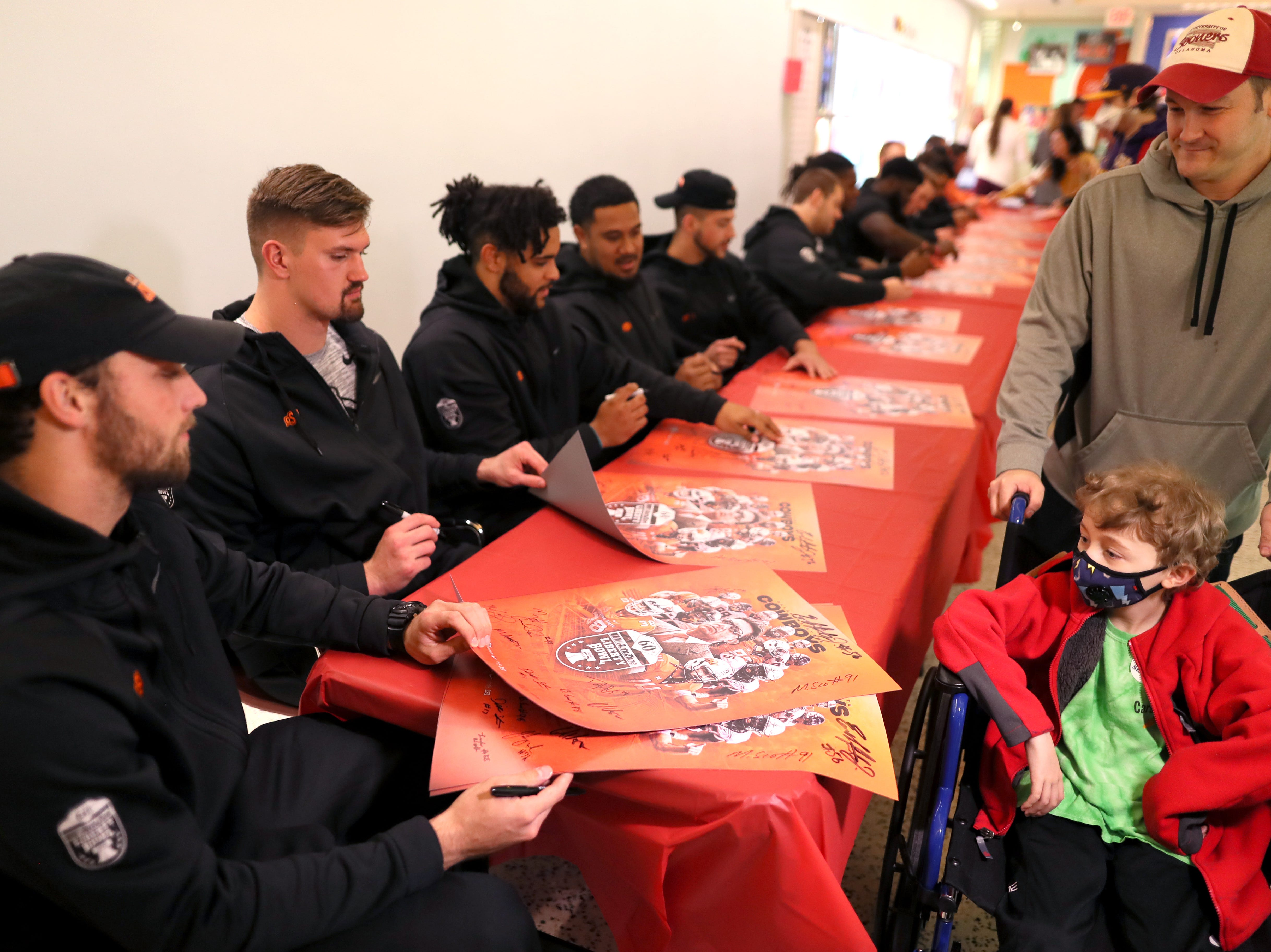 St. Jude patients meet the Oklahoma State football team Friday as the players made a visit to the hospital as a part of their tour of Memphis, before playing in Monday's Liberty Bowl.