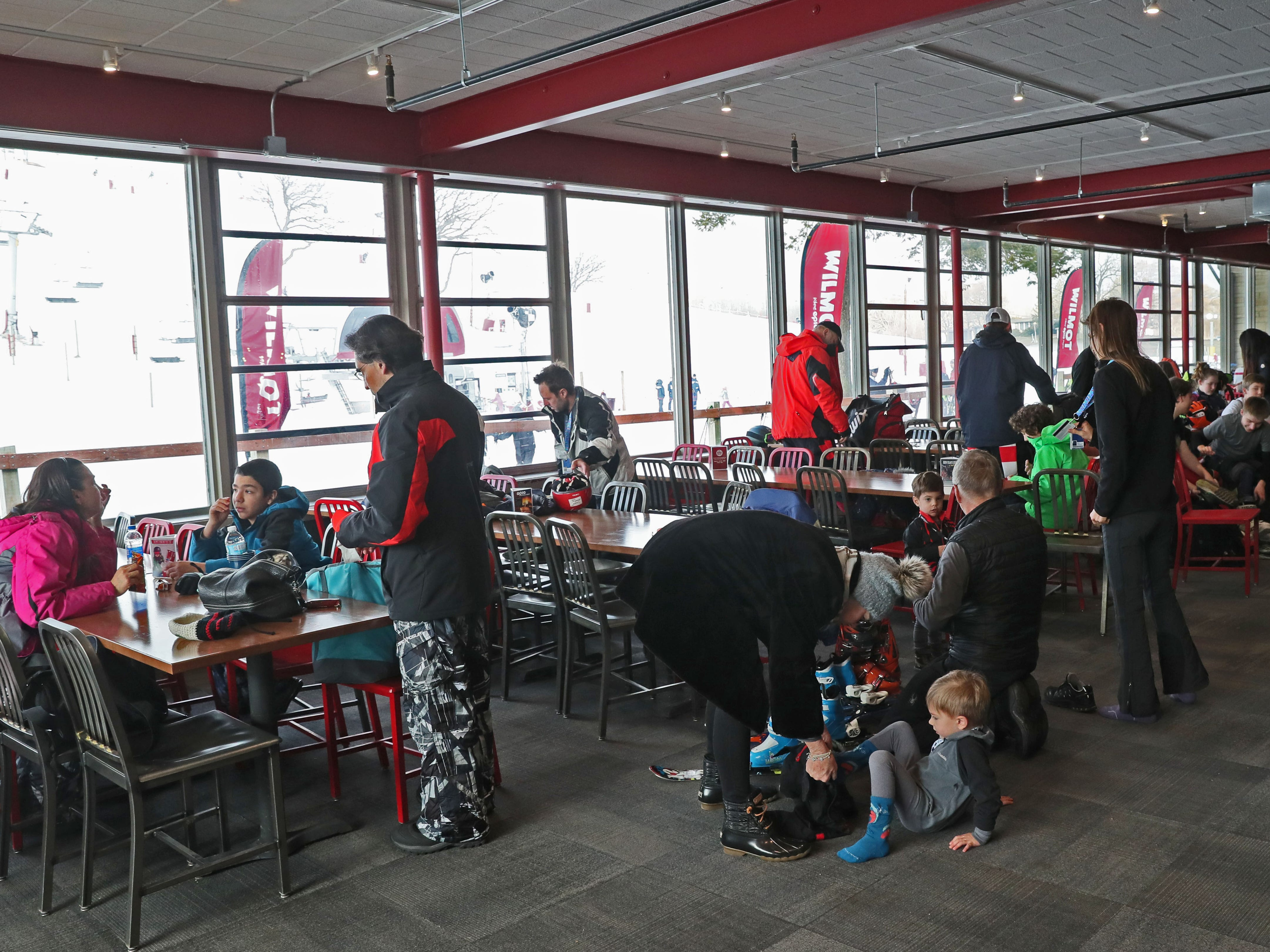 People get their gear on and can grab something to eat or warm up in the lodge area at Wilmot Mountain.