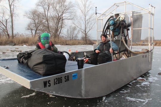 Zach Burgess, owner of Why Knot Fishing Charters, drives his self-made airboat on the ice of Green Bay during an ice fishing outing. Burgess is the only guide on the Wisconsin waters of Lake Michigan to run an airboat.