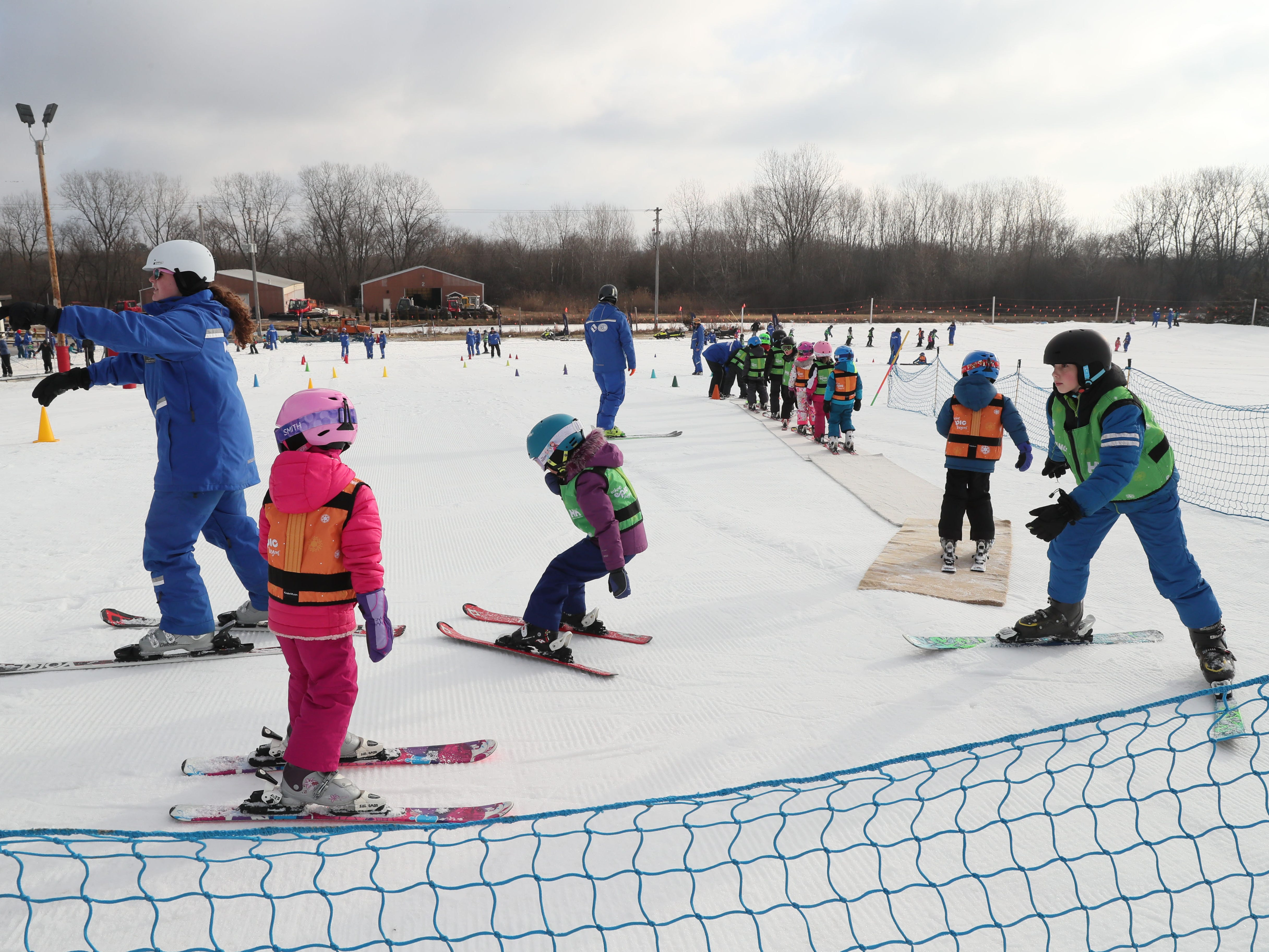 Children take classes to learn to ski at Wilmot Mountain.