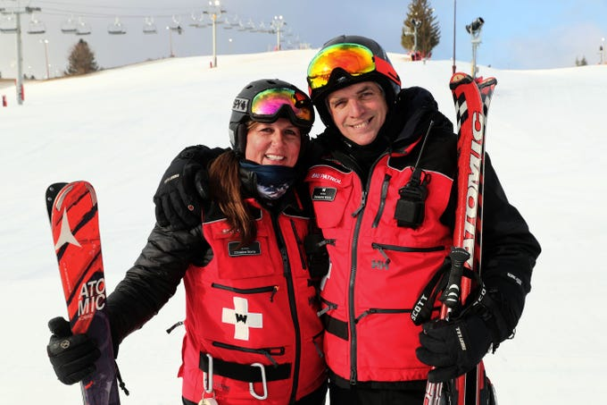 Christine Morris (left) and her husband, Christopher Morris, met at Wilmot Mountain ski hill near Wilmot and are on the ski patrol together there.