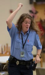 Correctional officer Sgt. Jill Sprangers dances during a game at the Taycheedah Correctional Institution in Fond du Lac, Wis. They were participants in Camp Reunite, a  program that allows children and their incarcerated mothers to spend time together.