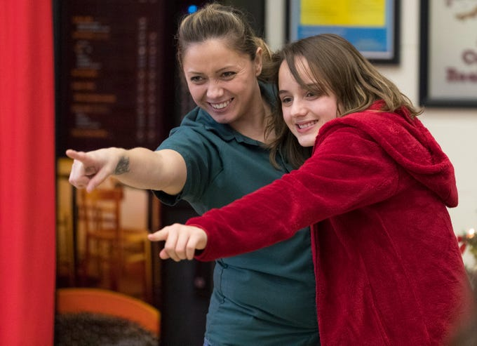 Adriana goofs around with her 10-year-old daughter, Tiana, at the Taycheedah Correctional Institution in Fond du Lac, Wis. They were participants in Camp Reunite, a  program that allows children and their incarcerated mothers to spend time together.