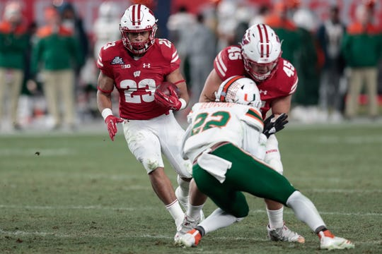 UW sophomore running back Jonathan Taylor (23) will return next season with 4,171 rushing yards already under his belt.