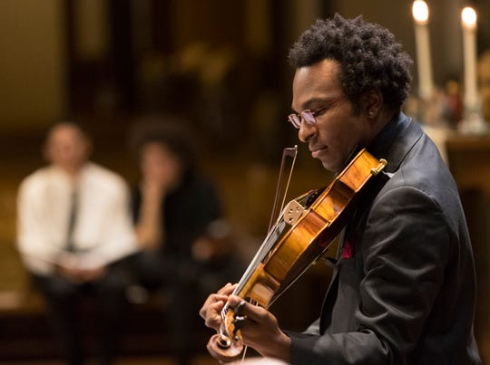 Musician Dayvin Hallmon plays at a Memorial Concert for Milwaukee's Killing of Innocents at All People's Lutheran Church, 2600 N. 2nd St. in Milwaukee, Wis.