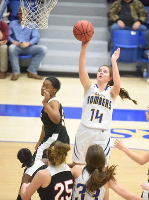 Mountain Home's Kyra Pinn puts up a shot during the Lady Bombers' 74-41 victory over Hermitage on Thursday night.