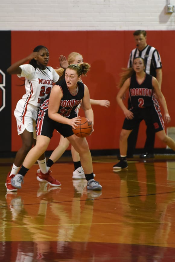 Boonton Vs. Morris Hills girls basketball game at the Morris Hills Holiday Tournament in Rockaway on Friday December 28, 2018. (From left) MH#24 Semaya Turner, B#23 Devin Gibbs and B#2 Sara Rios.