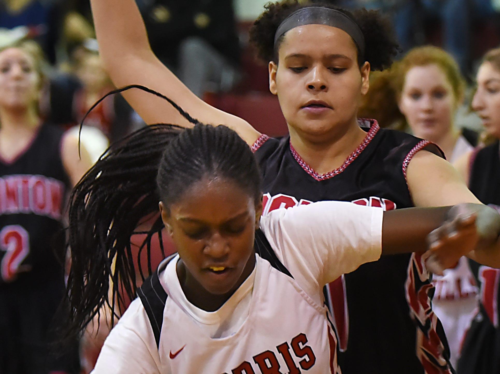 Boonton Vs. Morris Hills girls basketball game at the Morris Hills Holiday Tournament in Rockaway on Friday December 28, 2018. MH#24 Semaya Turner and B#31 Bianca Morc.