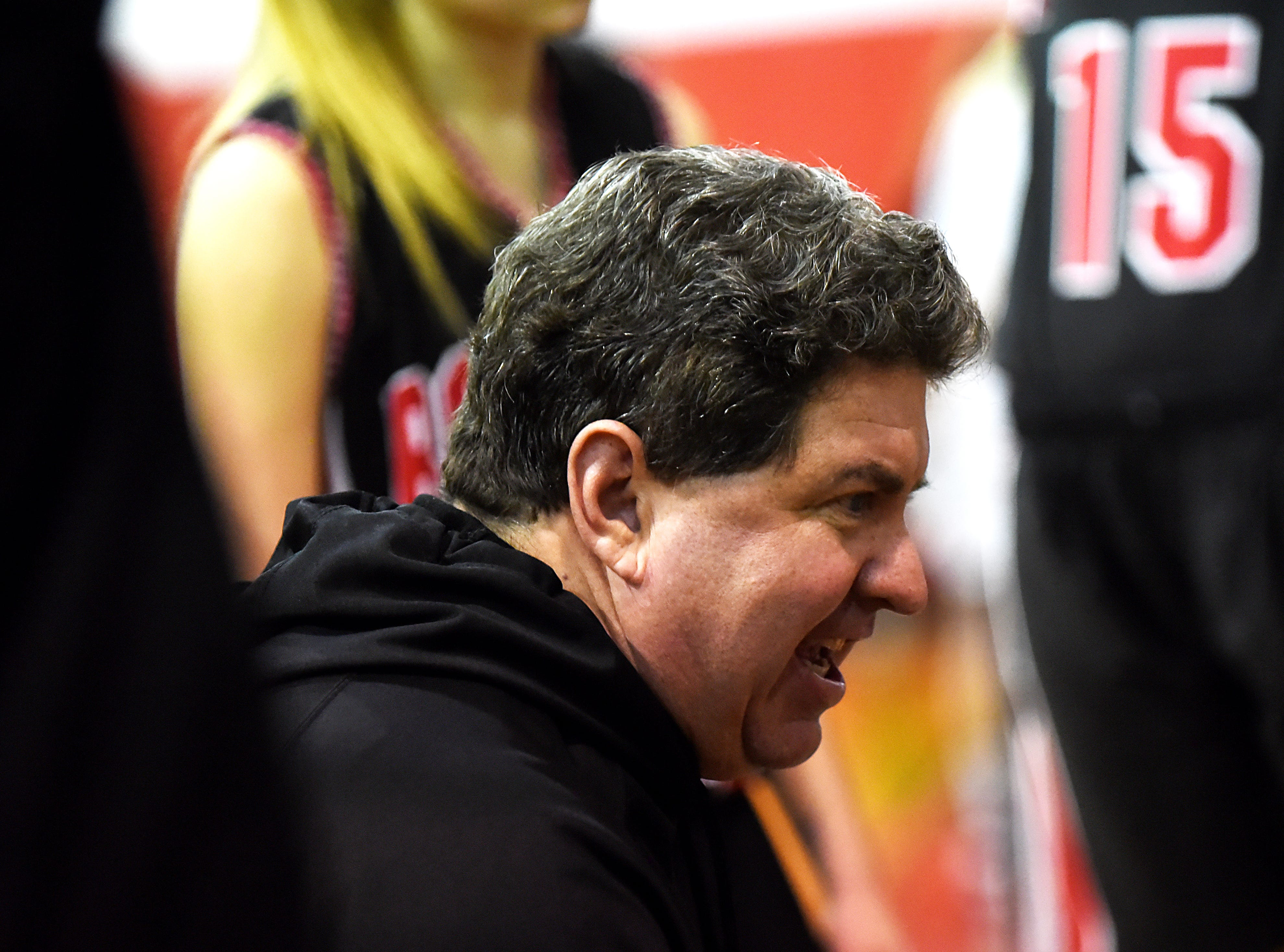 Boonton Vs. Morris Hills girls basketball game at the Morris Hills Holiday Tournament in Rockaway on Friday December 28, 2018. Boonton coach Mike Carlin talks with the team.