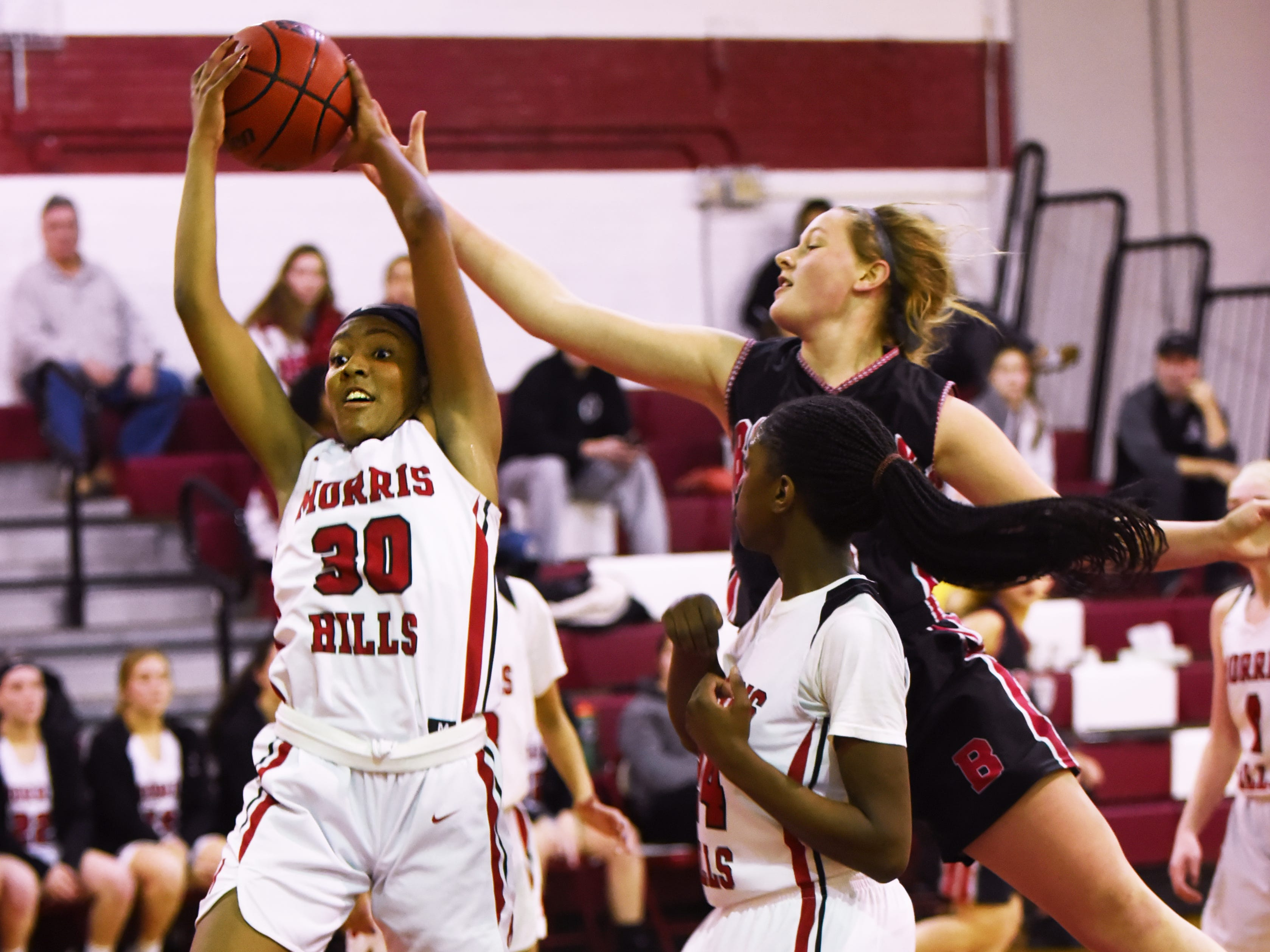 Boonton Vs. Morris Hills girls basketball game at the Morris Hills Holiday Tournament in Rockaway on Friday December 28, 2018. MH#30 Tamrya Turner has the ball.